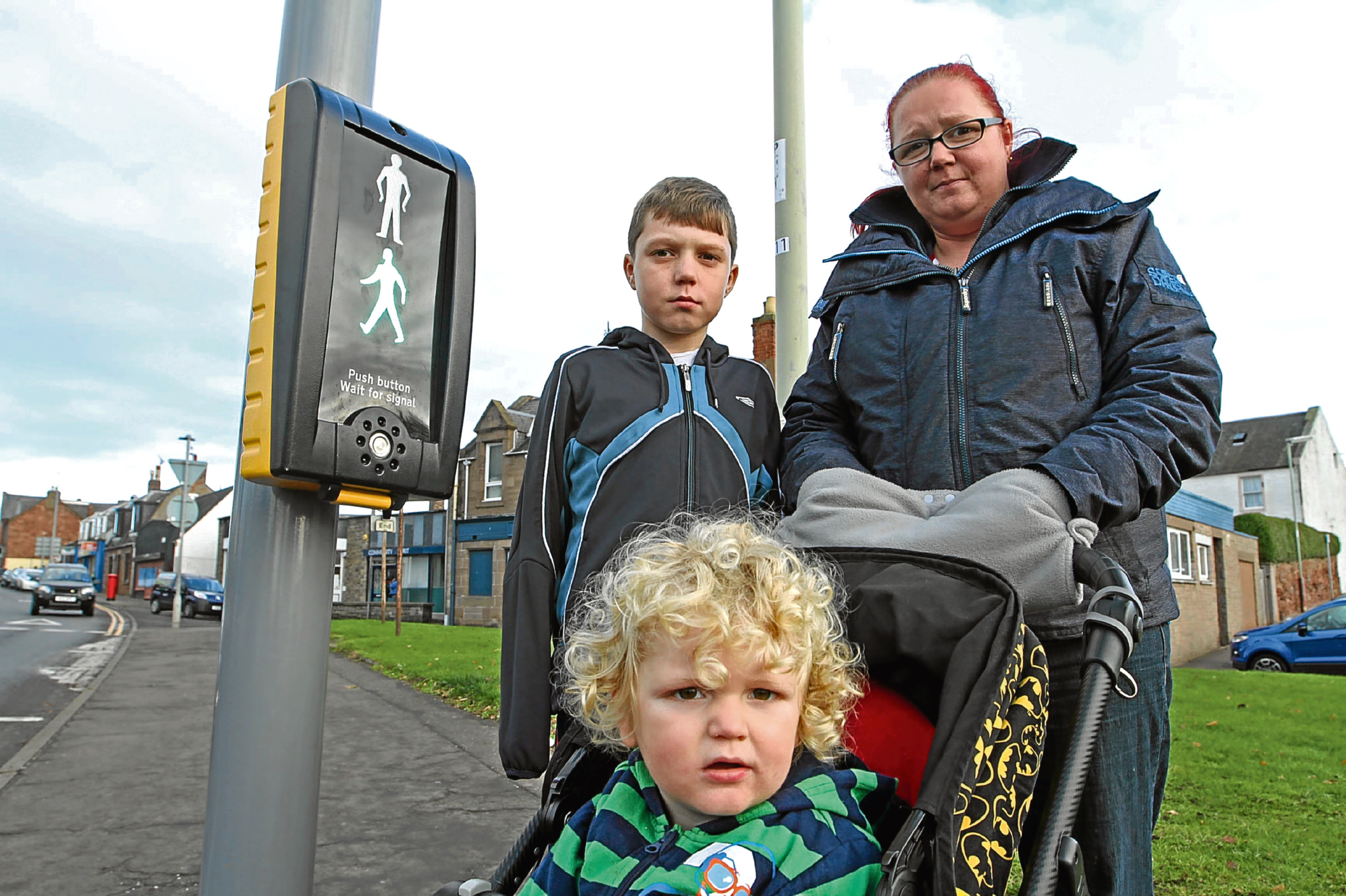 Mandy Laidlaw and her sons Jak and Blake at the crossing where the incident happened.