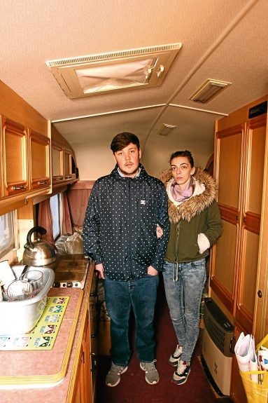 The couple inside the cramped caravan