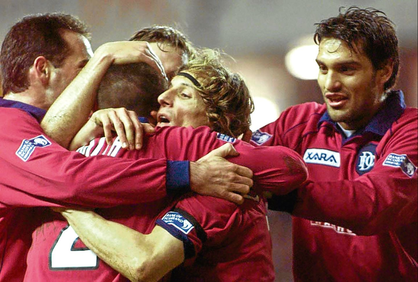 Claudio Caniggia is mobbed by his team-mates after scoring the opener for Dundee when they beat Rangers 2-0 at Ibrox in March 2001 — the last time the Dee tasted success at the Govan stadium.