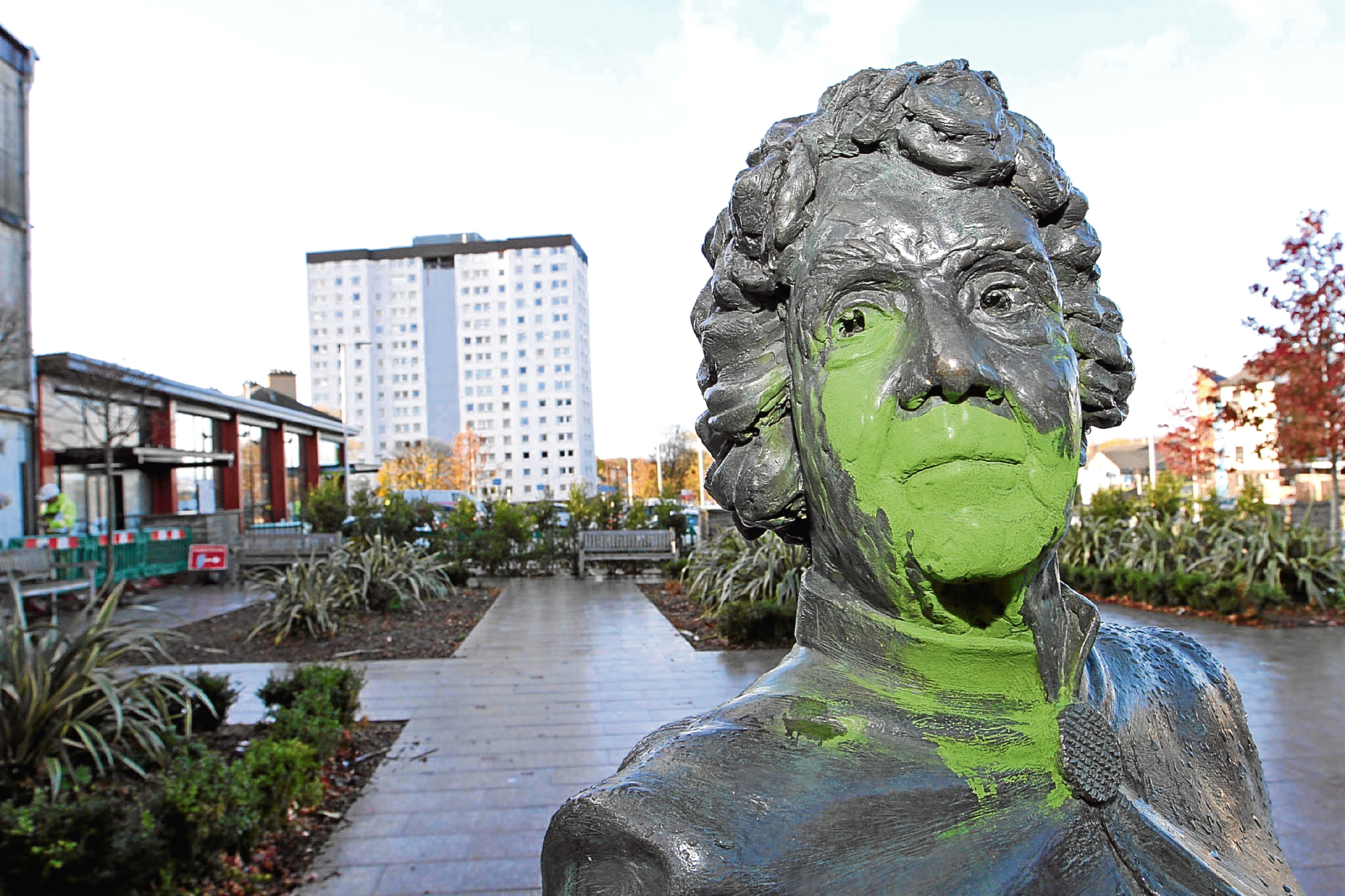 A statue in Lochee has been vandalised with green paint.