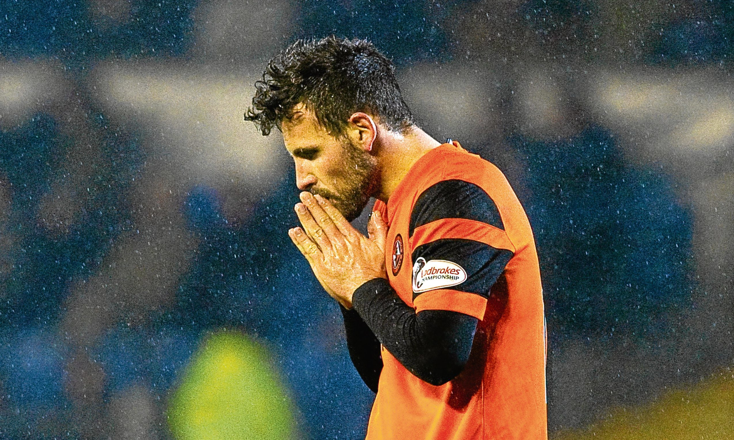 Dundee United midfielder Tony Andreu leaves the Cappielow pitch dejected at not picking up three points on Saturday.