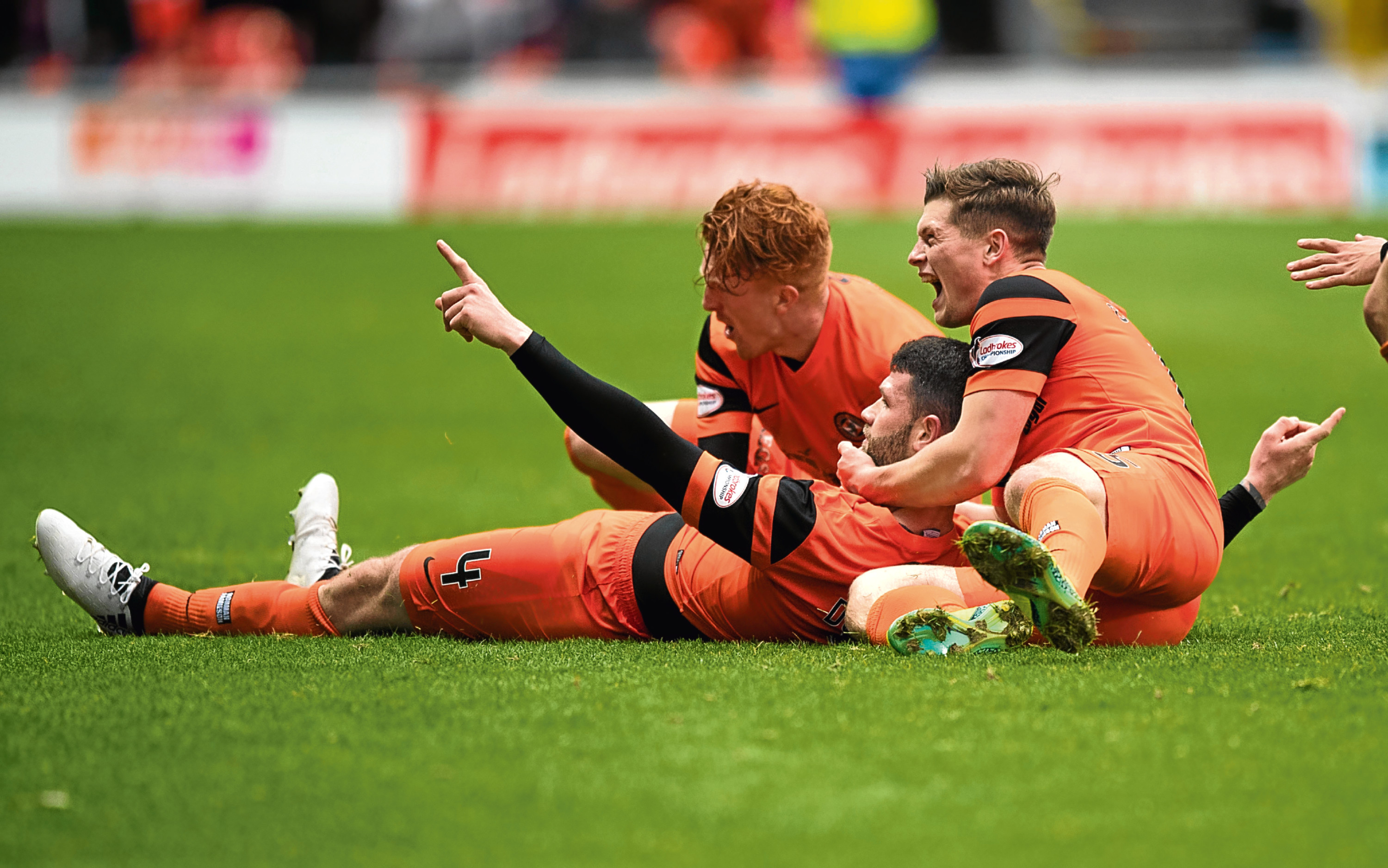 Dundee United centre-half Mark Durnan (centre) has had a run of excellent displays and bagged three vital goals since regaining his starting XI spot in Ray McKinnon's heavily-revised team.