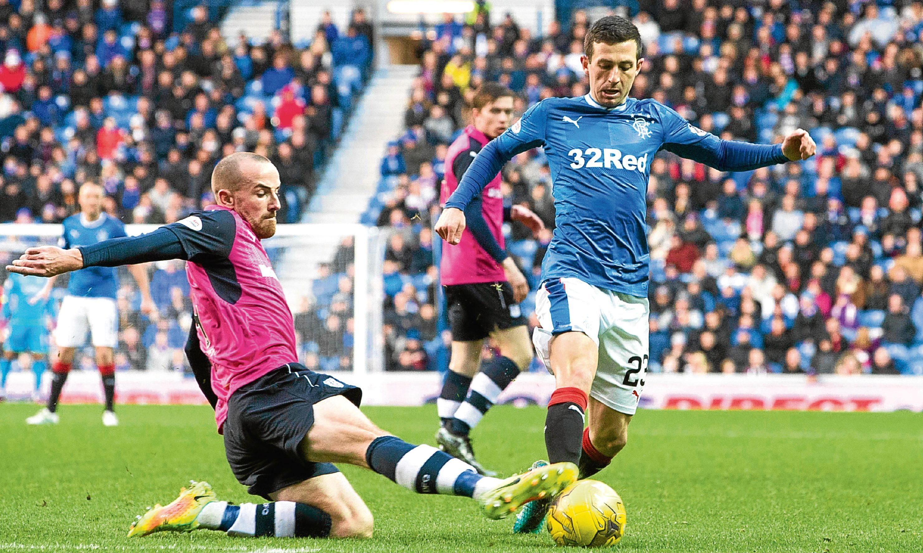 Dundee's James Vincent displays the kind of fighting qualities Dundee will need when Inverness visit Dens as he puts in a timely tackle against Rangers' Jason Holt last Saturday.