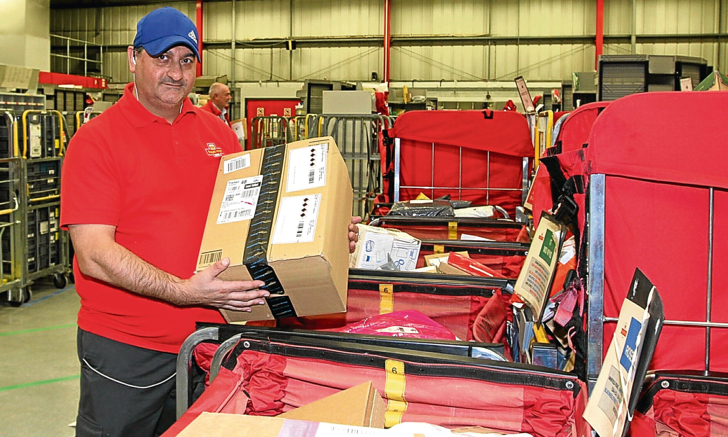 David Fotheringham begins the daunting process of sorting the festive mail.