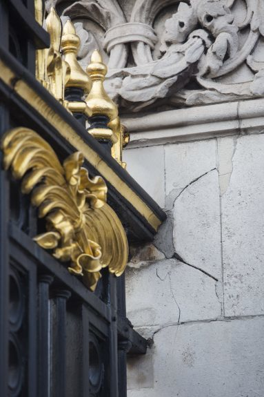 A cracked pillar is pictured by the front gates of Buckingham Palace