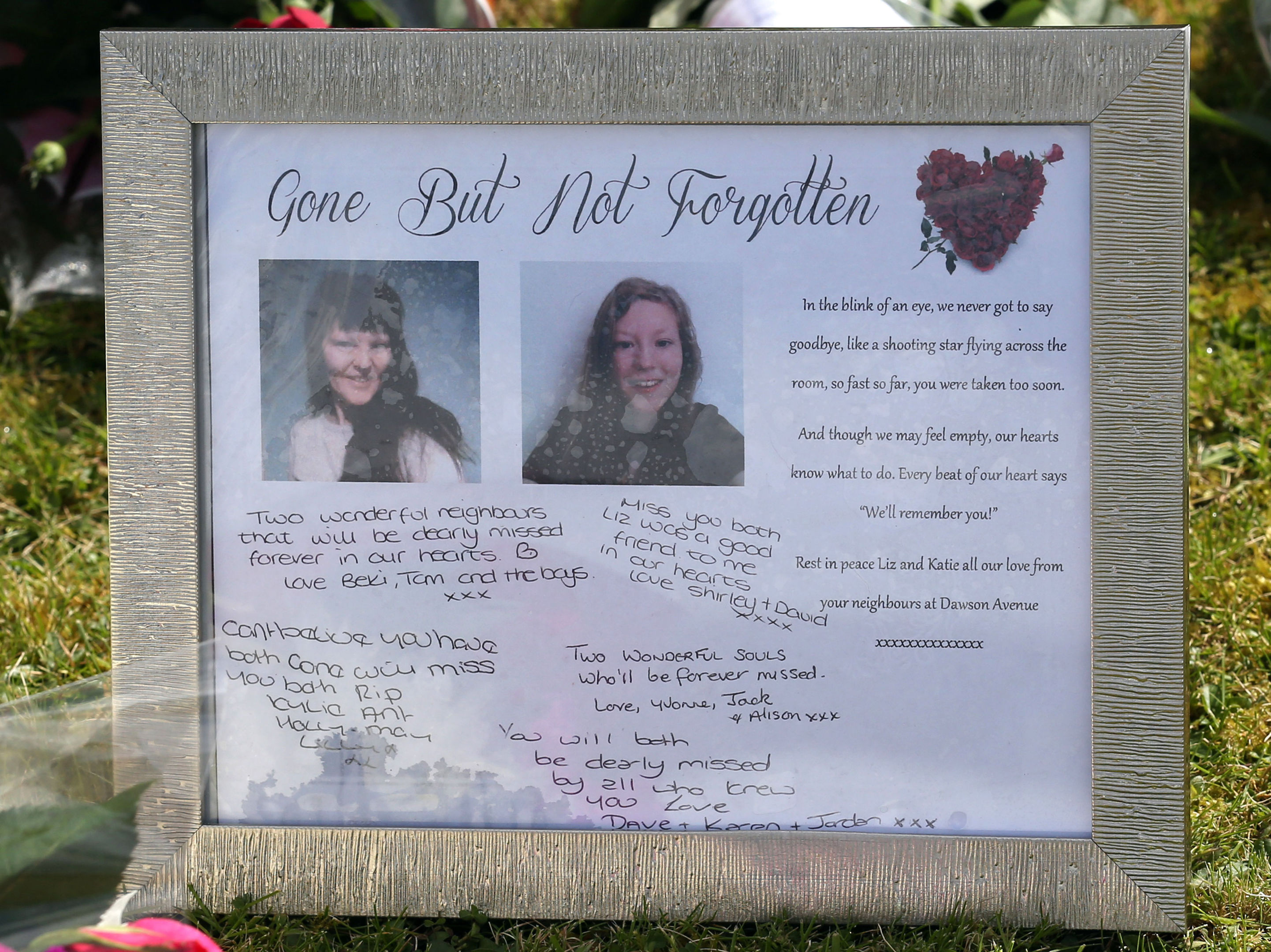 Tributes left outside the house where the bodies of 49-year-old Elizabeth Edwards and 13-year-old Katie were found