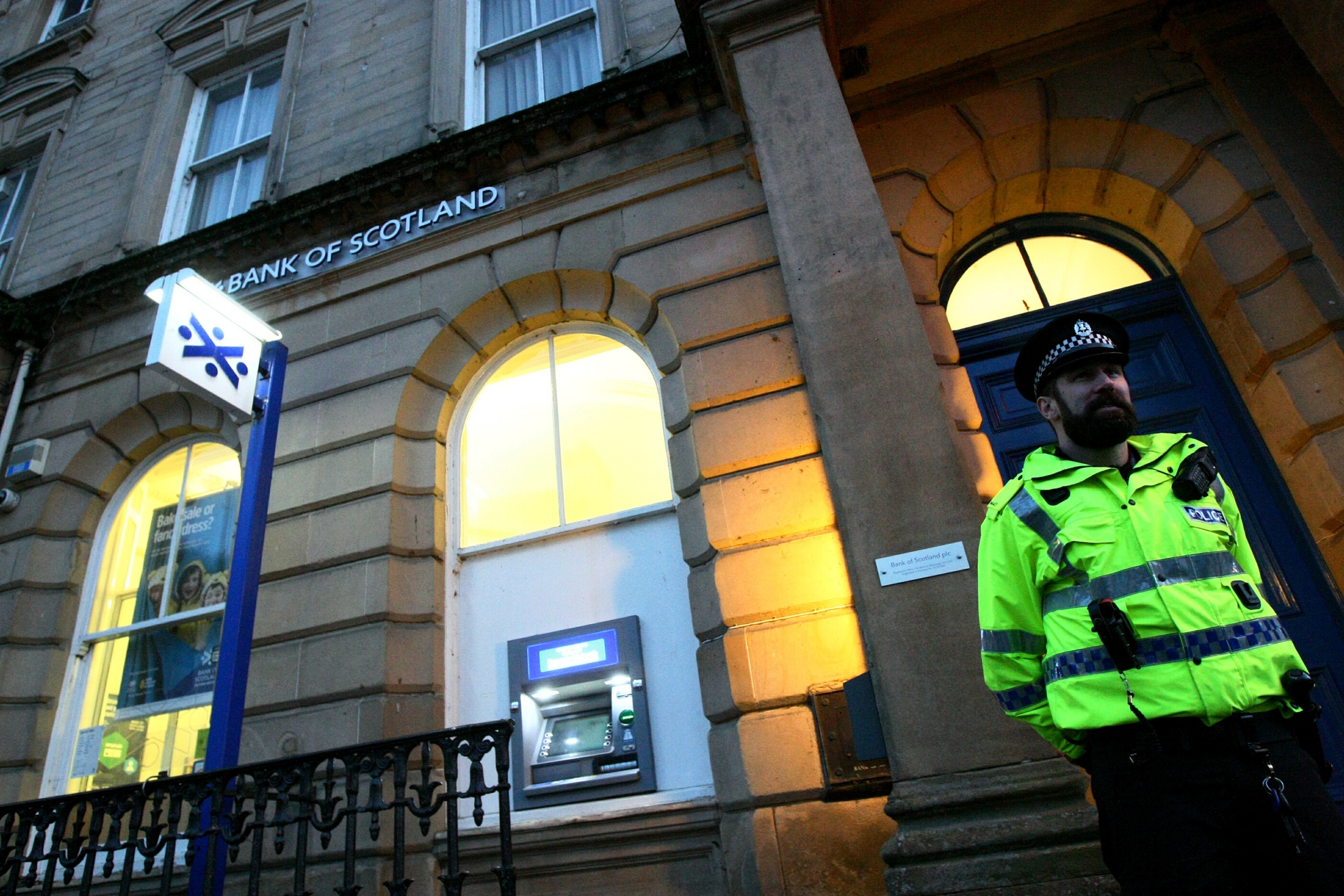 An officer stands guard outside the Bank of Scotland in Dunkeld