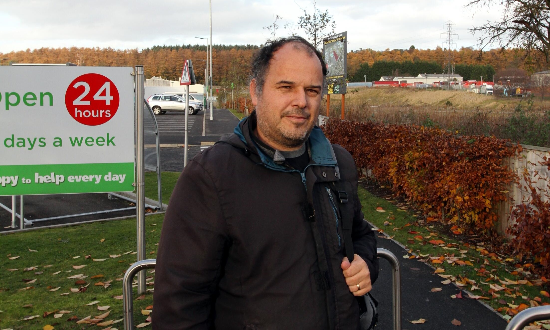 Iain Hendry near the site of the planned store.