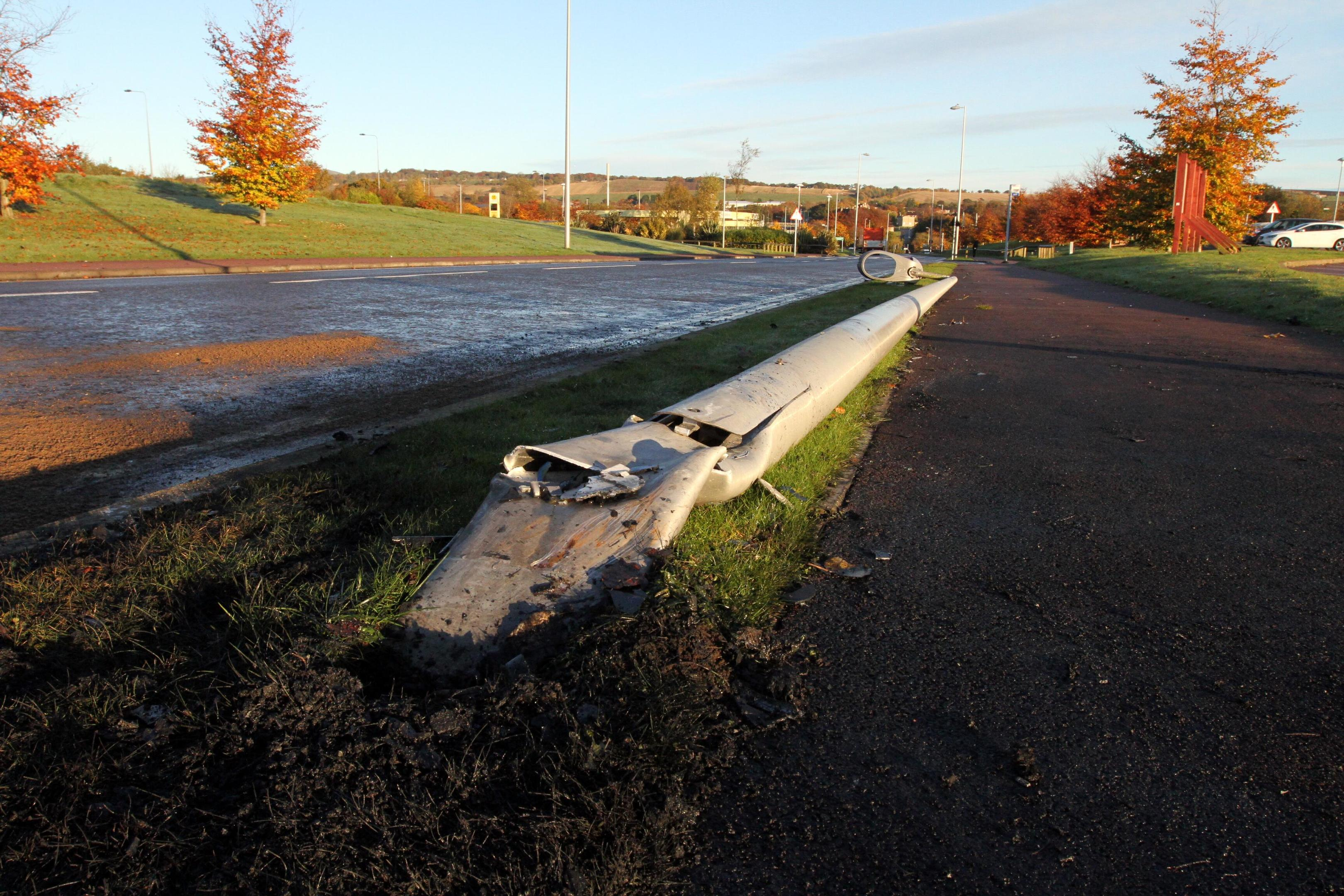 The flattened lamppost at the scene of the fire.