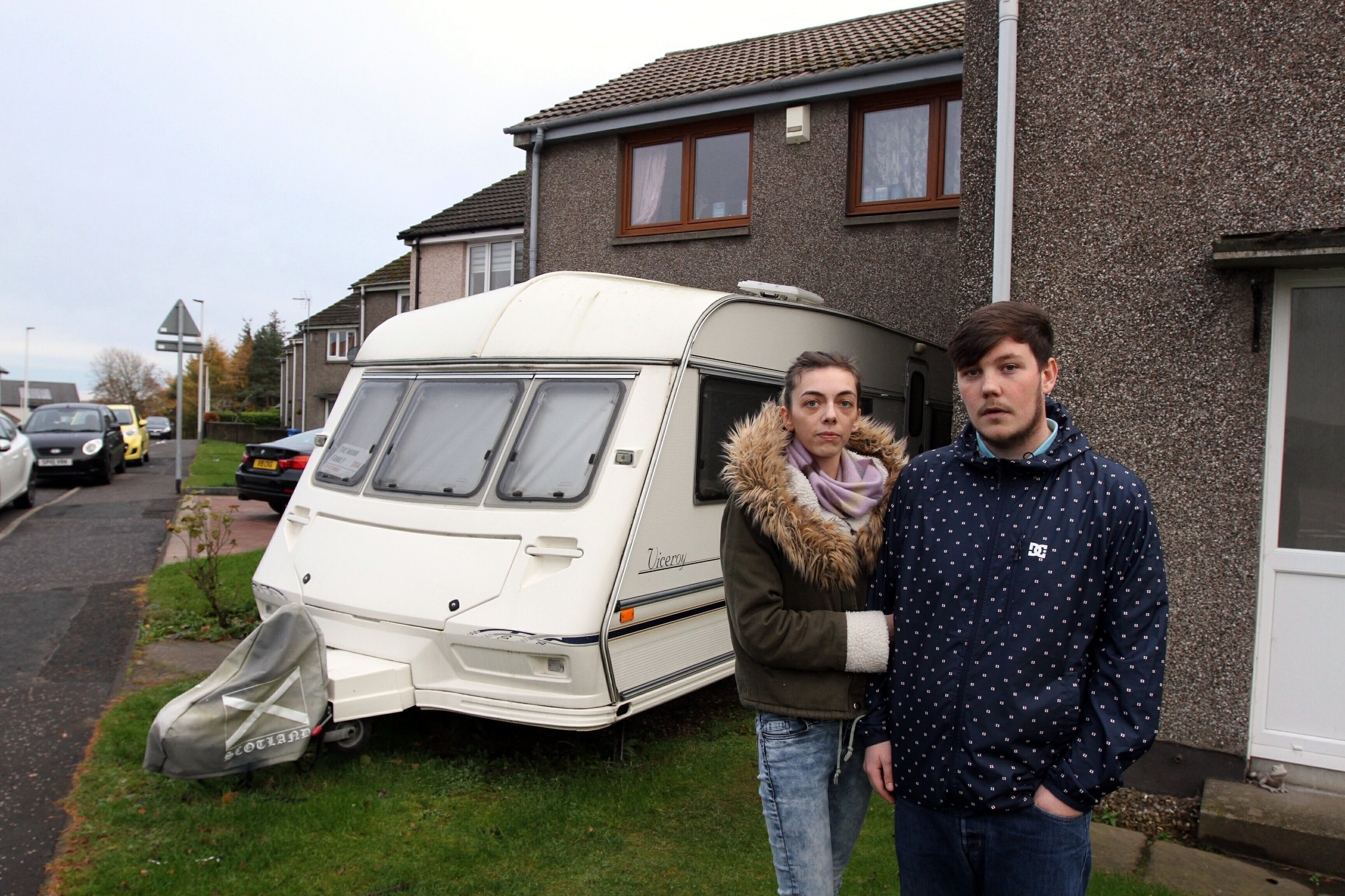 The couple beside their caravan in Mill o' Mains