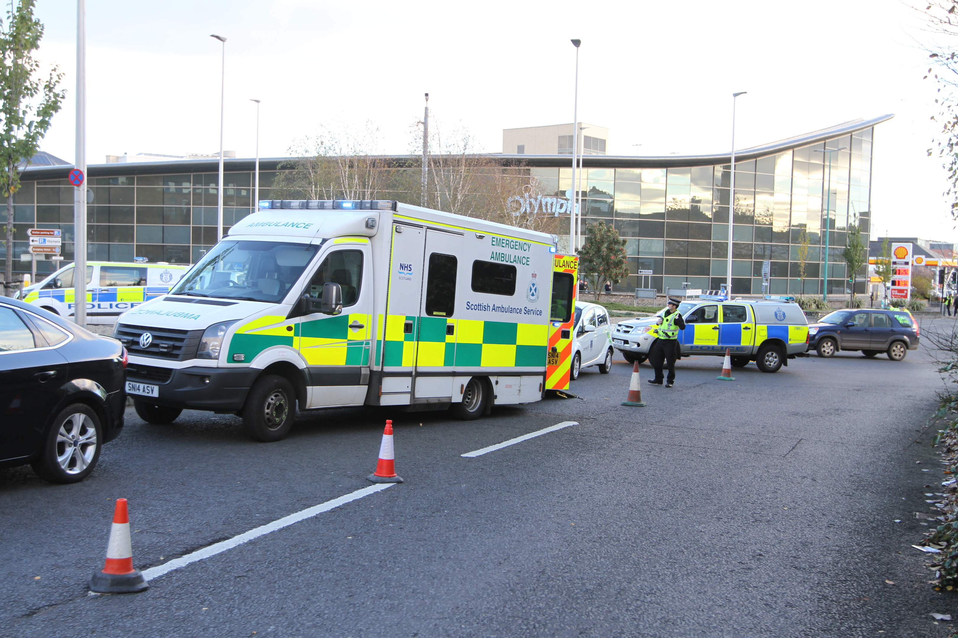 Emergency services at the scene, near the Olympia.