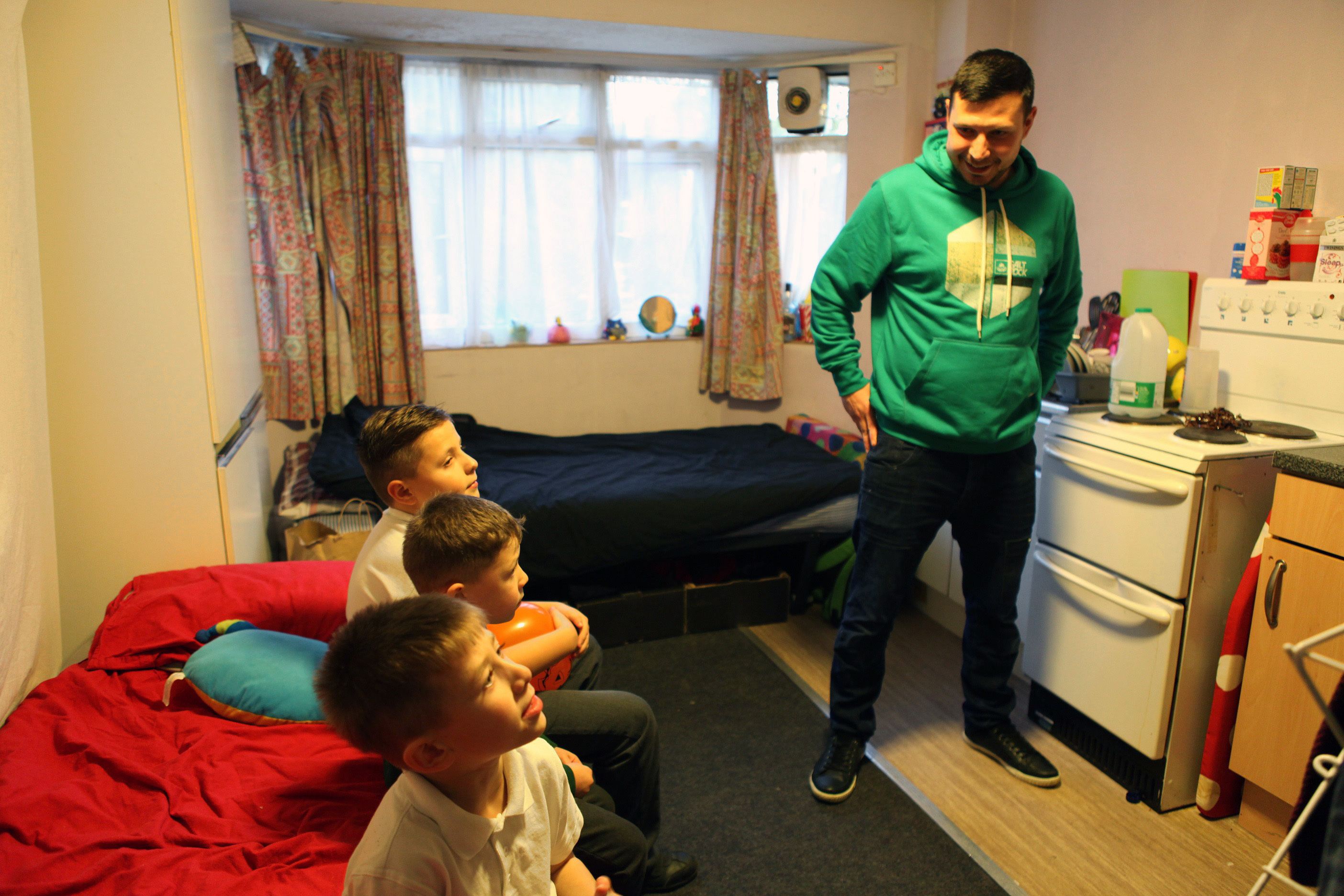 One man and his children who are living in an emergency hostel after becoming homeless.