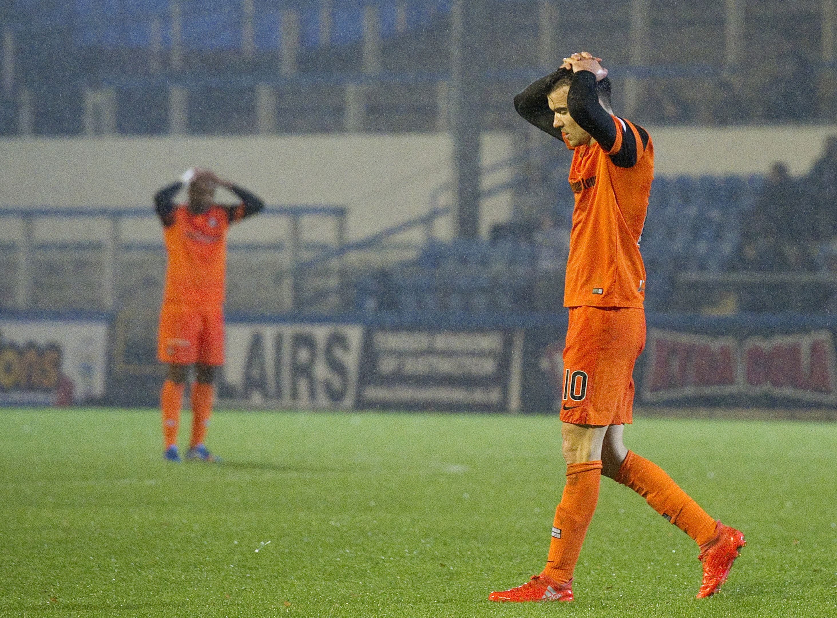 Dundee United's Scott Fraser and William Edjenguele  can't hide their disappointment at full time