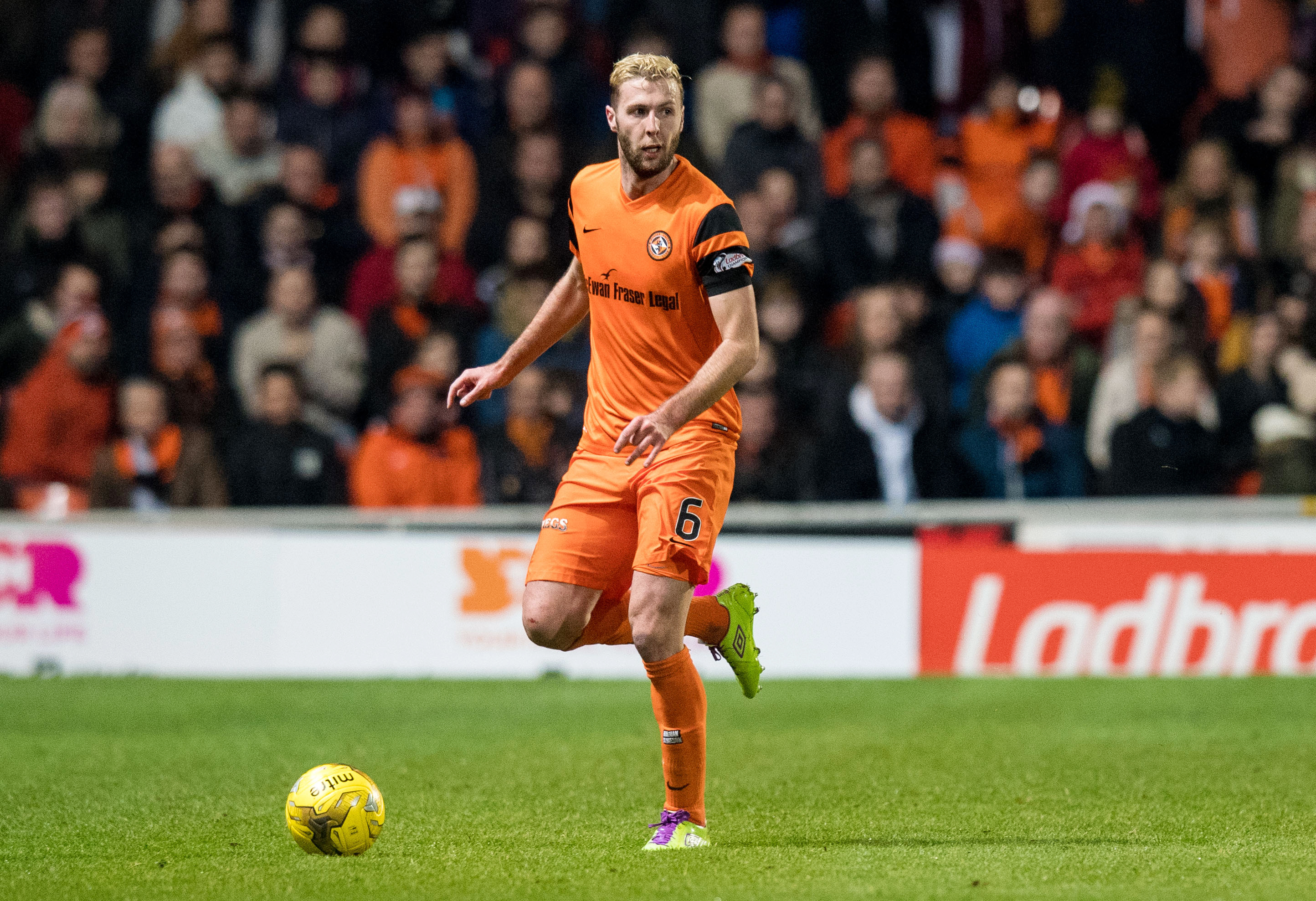 Lewis Toshney of Dundee United in action