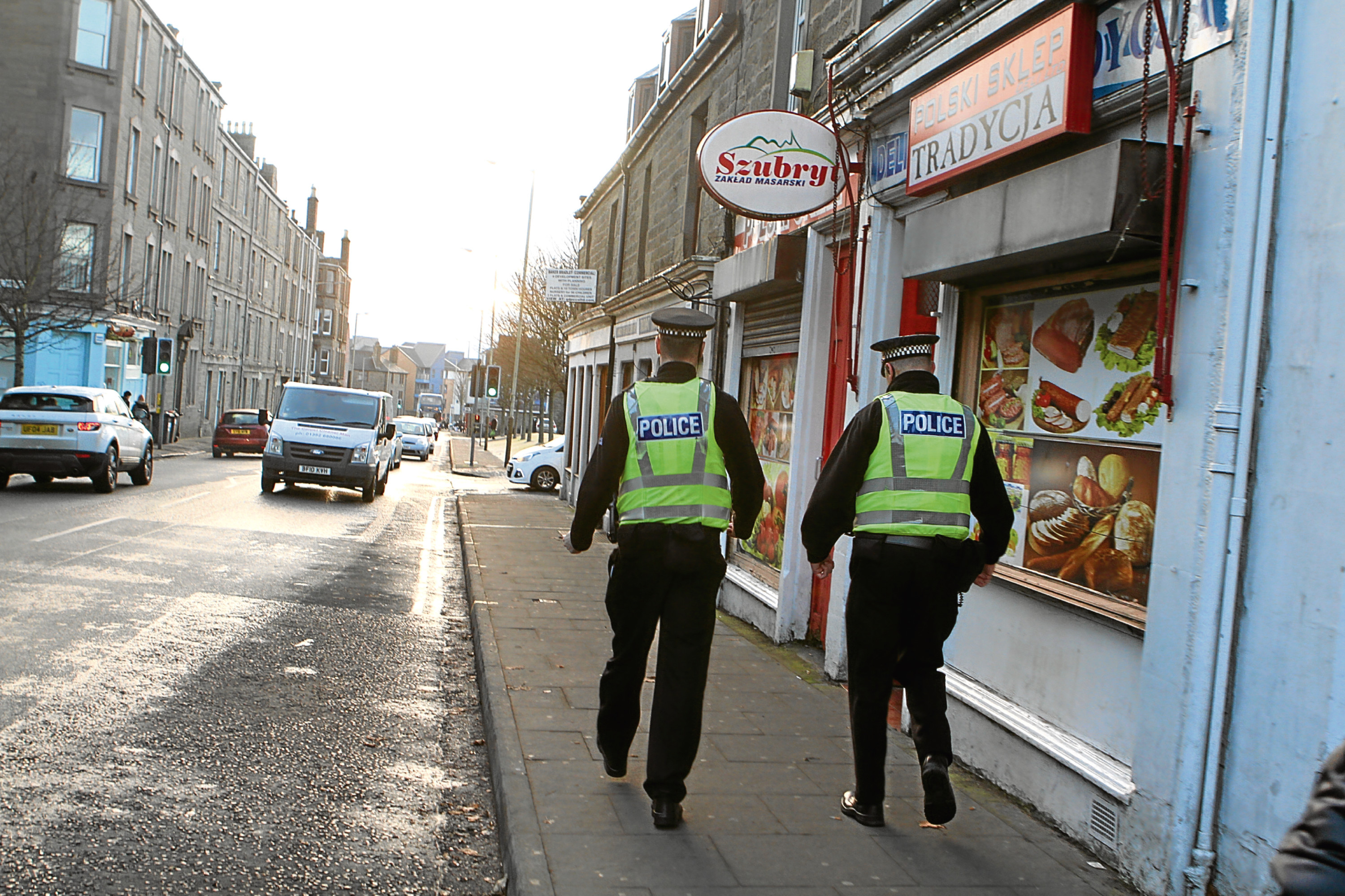 Police on the street in Maryfield and Wendy Sturrock, a local resident and business owner.