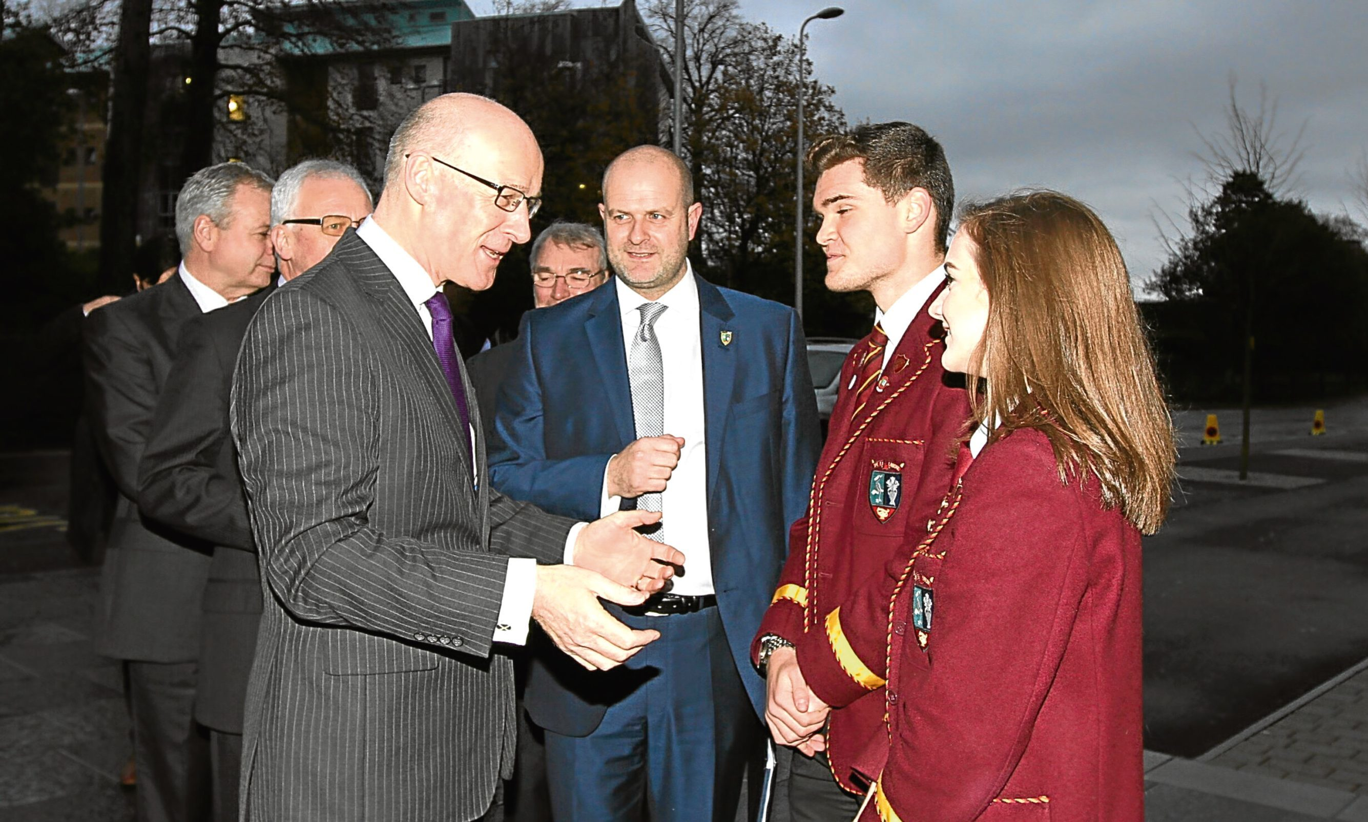 John Swinney chats with headteacher Barry Millar, headgirl Kirsten Ferrier and headboy Sam Pirrie.