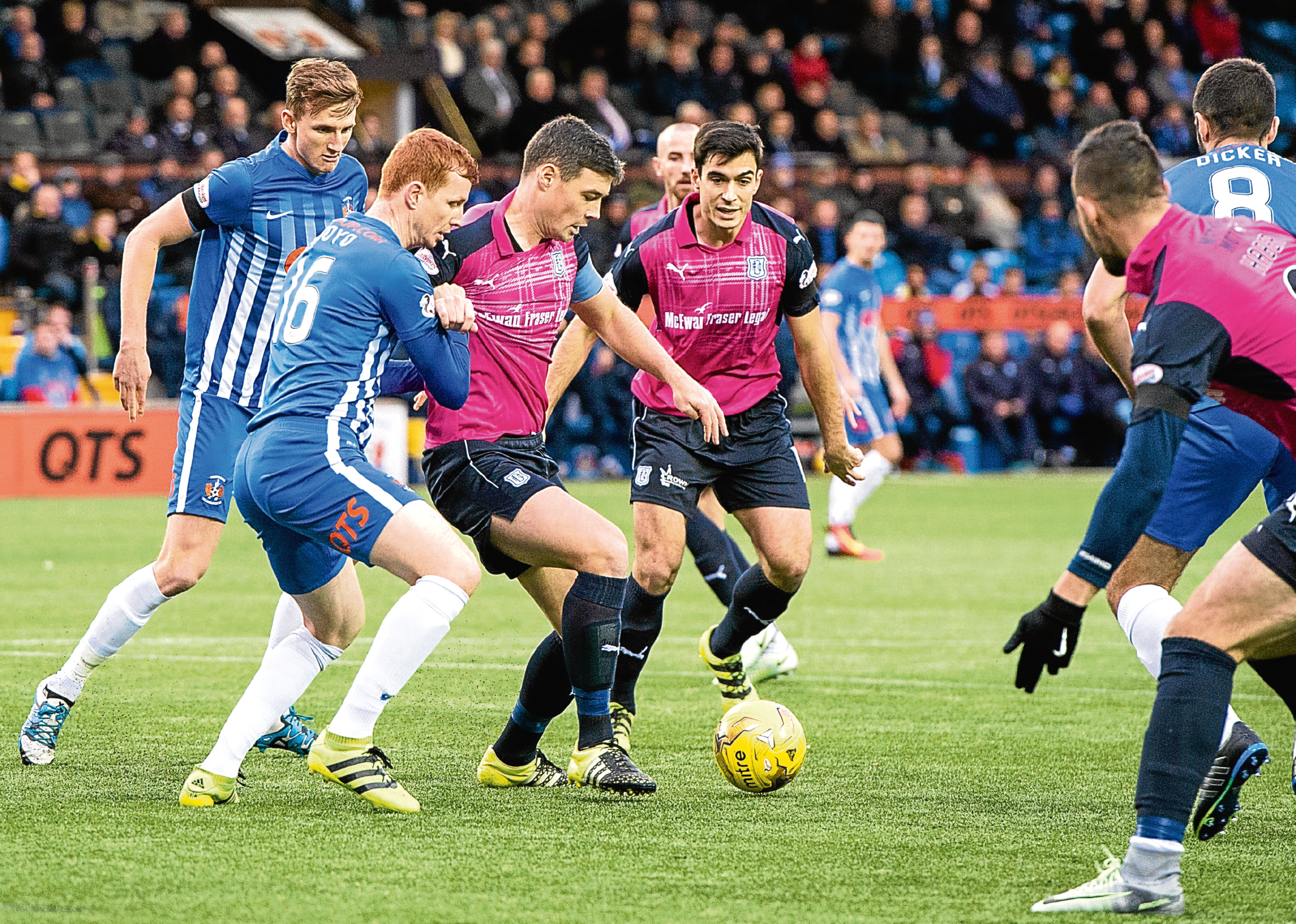Darren O'Dea (centre) holds off Scott Boyd as the Dark Blues slip to a 2-0 defeat at Kilmarnock — something the Dundee defender is determined to correct this weekend with another home win.