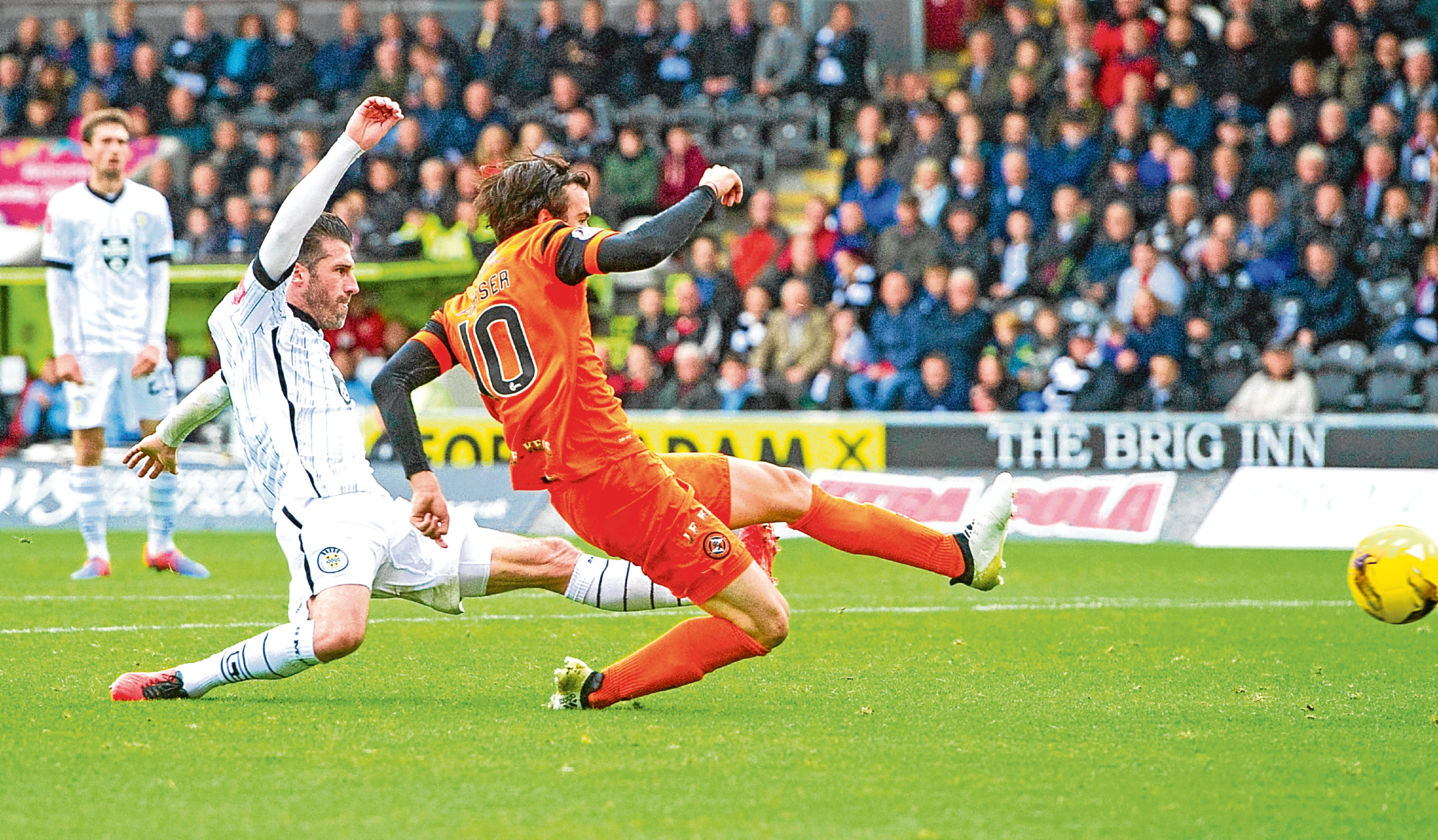 Dundee United's Scott Fraser slips in ahead of St Mirren's Rocco Quinn to put the Tangerines in front during their 2-0 win in the Championship game at the Paisley 2021 Stadium in October.