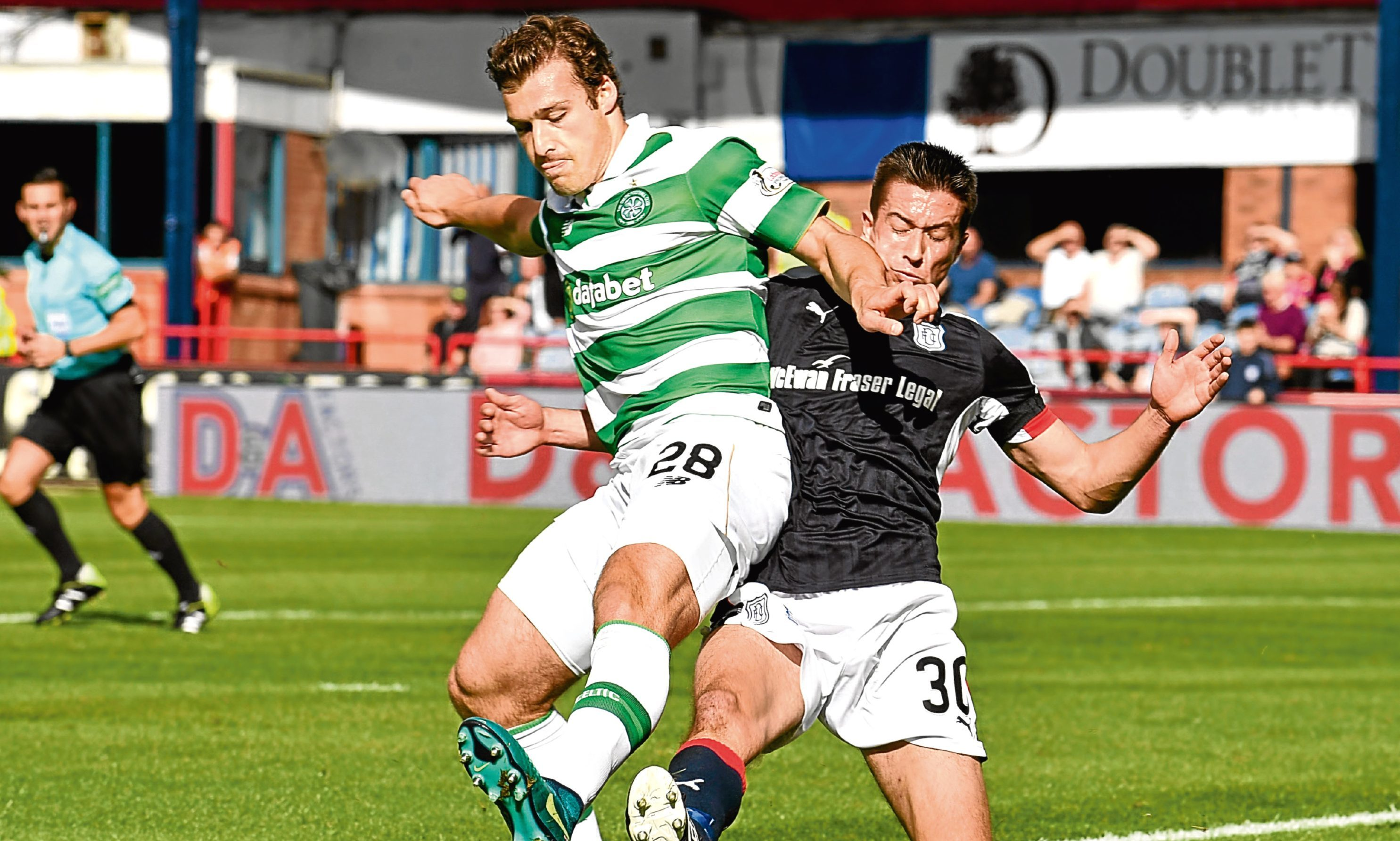 Kerr challenges Celtic's Erik Sviatchenko at Dens in October.