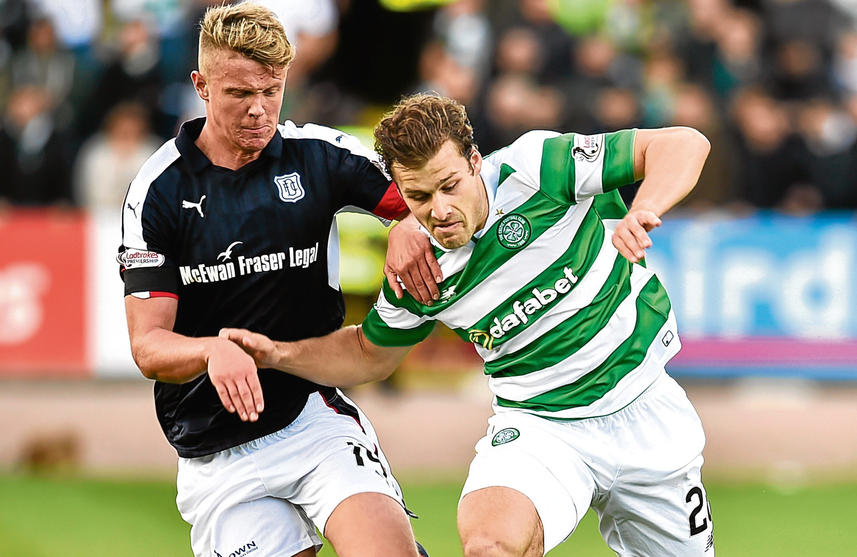 Dundee's Mark O'Hara battles for the ball against Erik Sviatchenko at Dens.