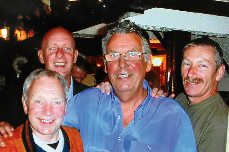 Kenny Nicoll (centre, right) ran The Barn pub in Barnhill for more than a decade.