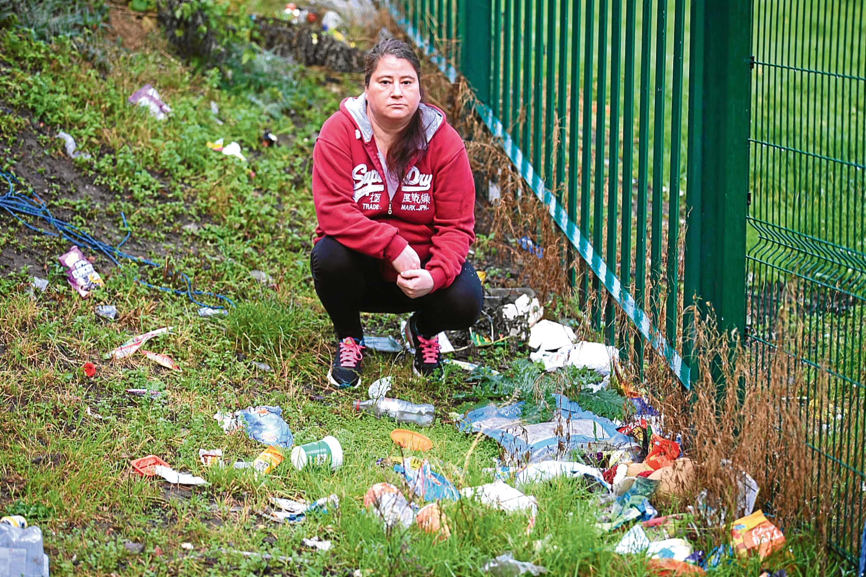 Charlotte Fraser, 41, who lives in Butterburn Square in Hilltown, surrounded by rubbish.