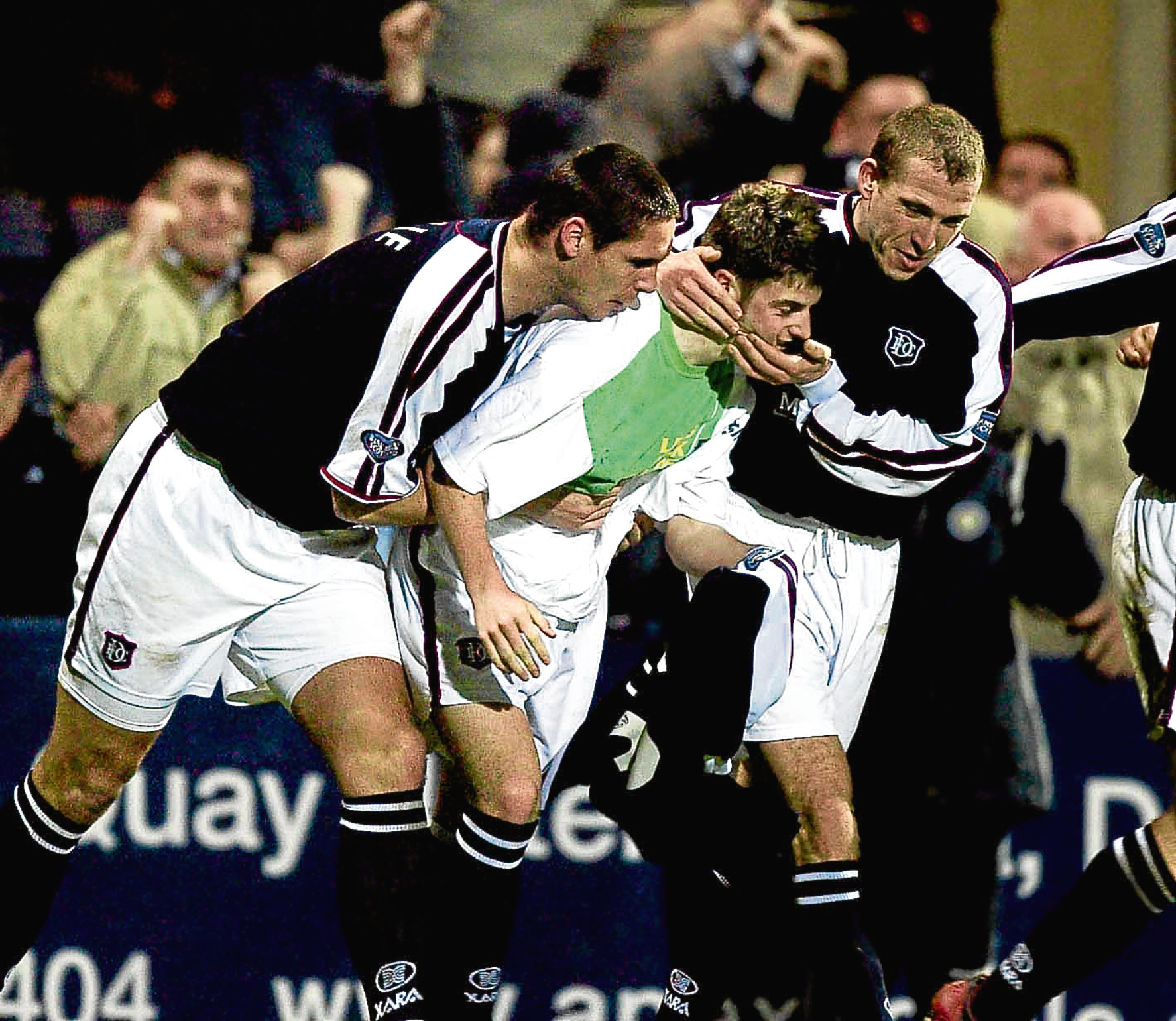 Lee Wilkie (left) and Garry Brady congratulate Dundee scorer Bobby Linn after his extra-time goal in 2003 lifted the gloom of administration and sent the Dark Blues into the semi-finals of the League Cup.