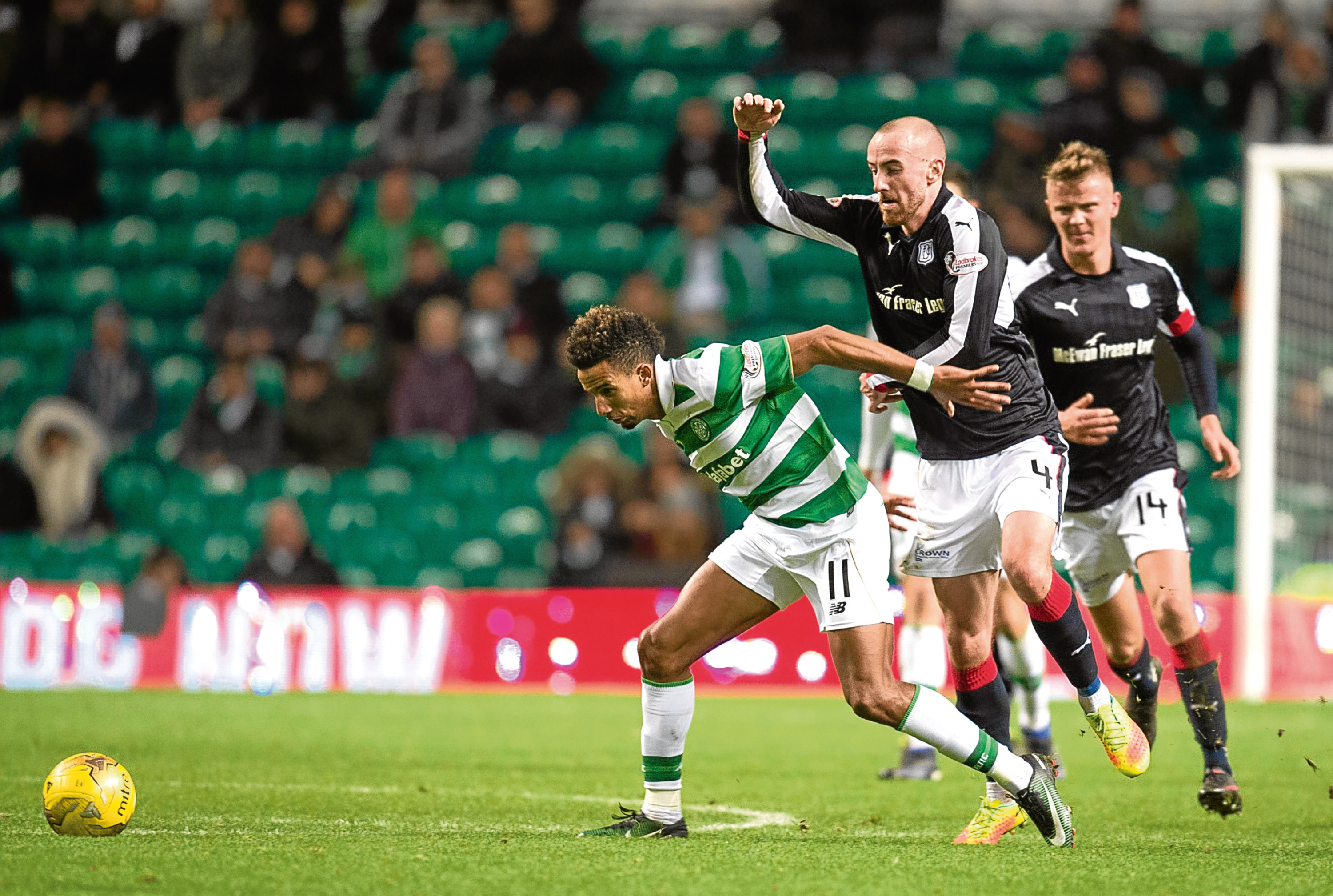 James Vincent pays close attention to Celtic's Scott Sinclair in Dundee's 2-1 loss at Parkhead last Saturday.