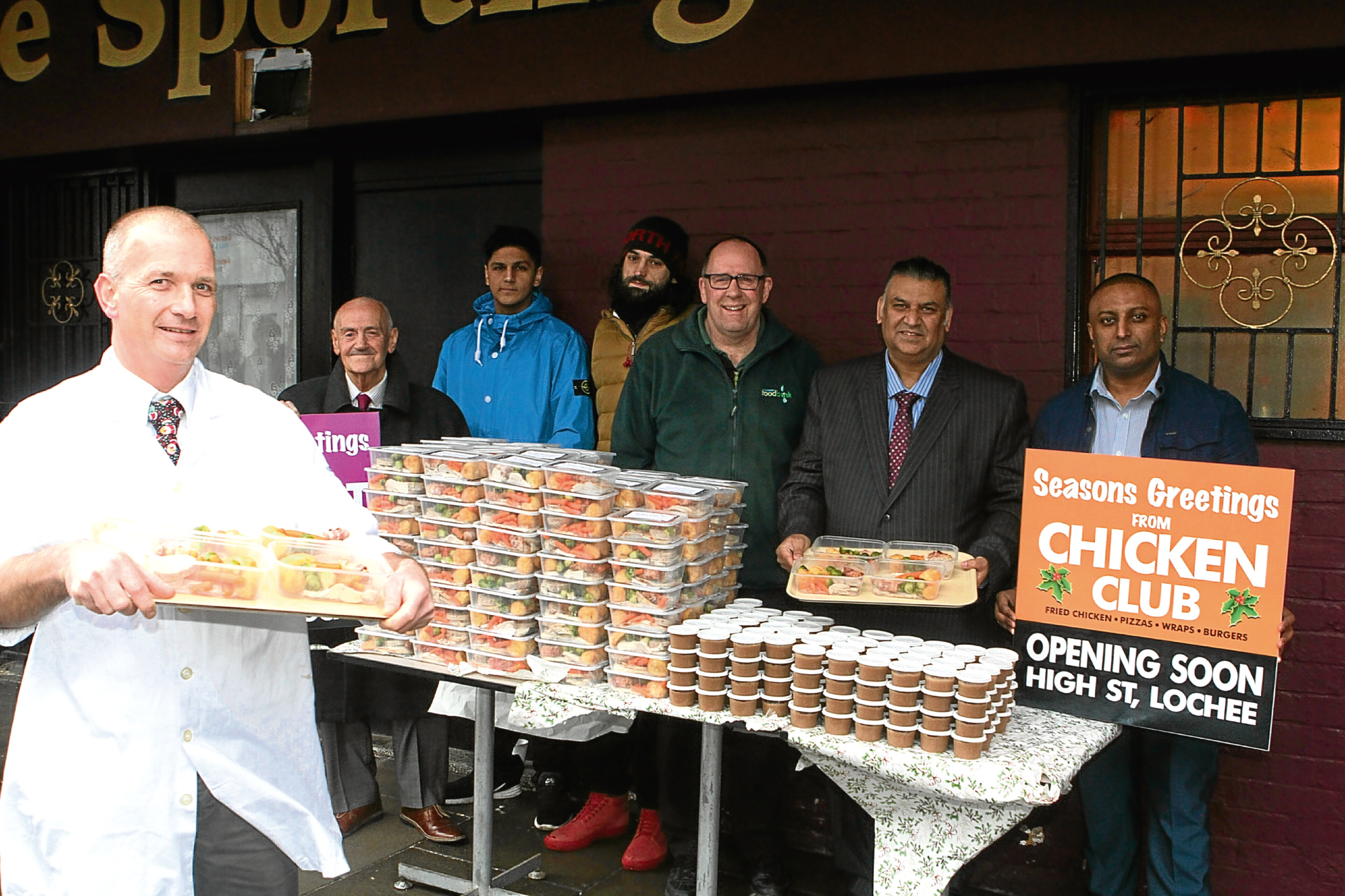 Pictured from left to right are George Jarron of Scott Brothers, Councillor Tom Ferguson, Usman Nasim, John Redmond, Ken Linton of Dundee Foodbank and Ibrar Ibrahim of Chicken Club.