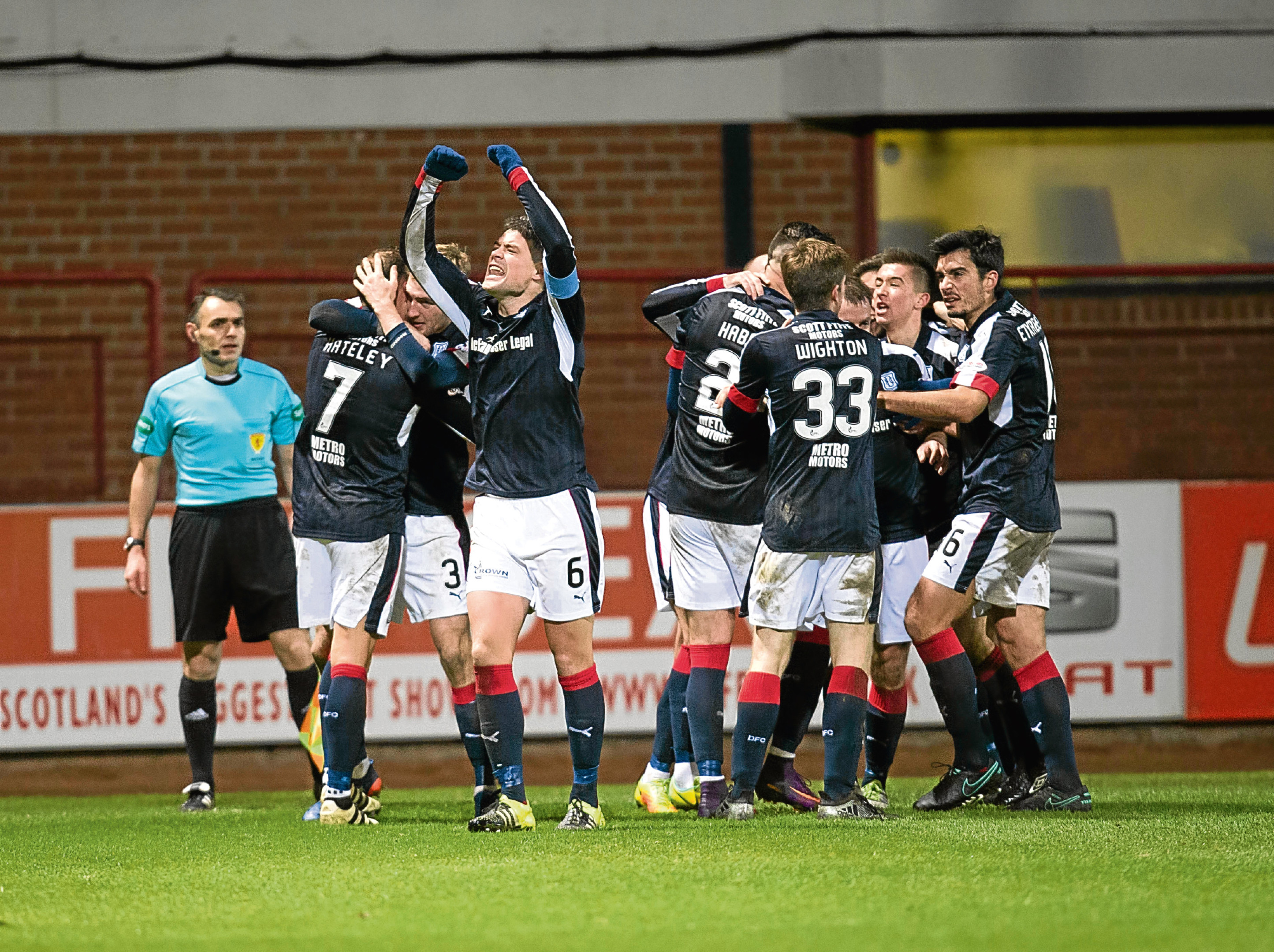 Dundee players celebrate the winning goal after a dramatic comeback against Heartd. Picture by David Young