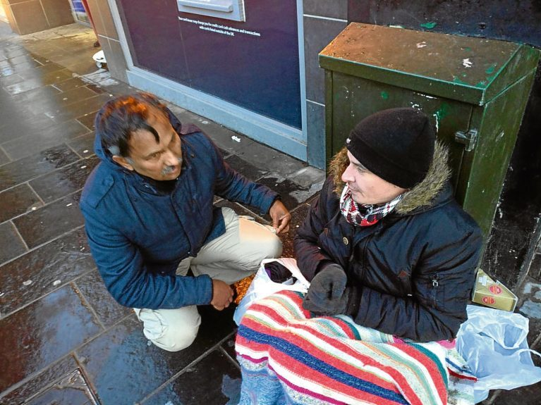 Dr Kabir speaking to a homeless man in Dundee.