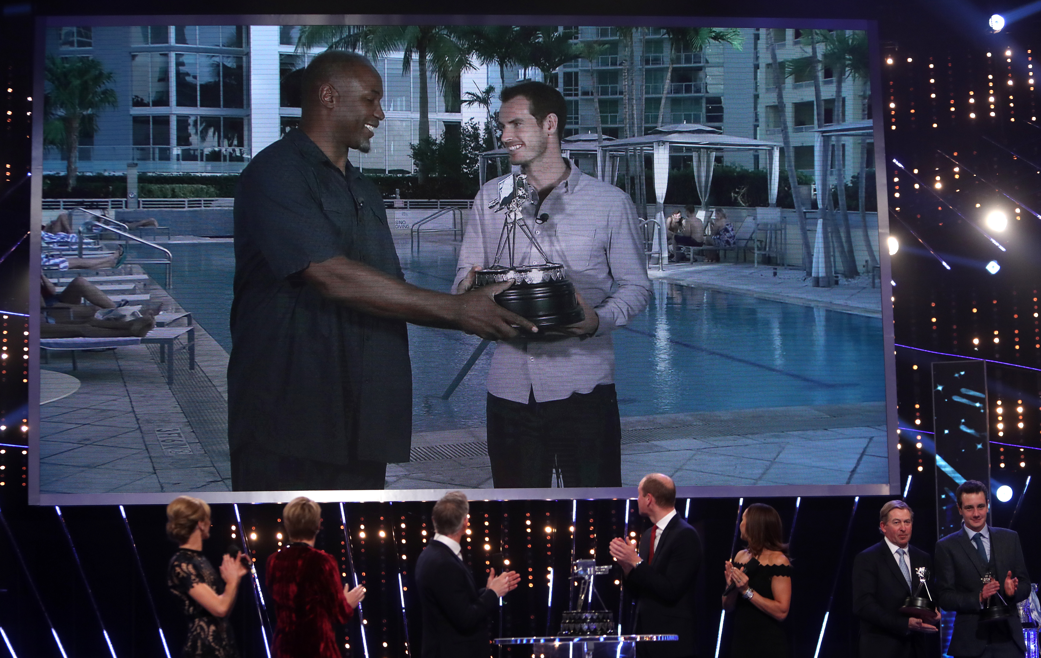 Andy Murray receives the Sports Personality of the Year award from Lennox Lewis.