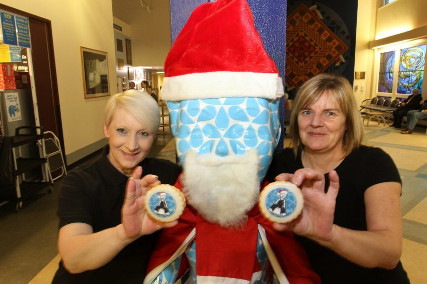 Yvonne Gray and Pam Cree with Rain Song Oor Wullie in his festive outfit.