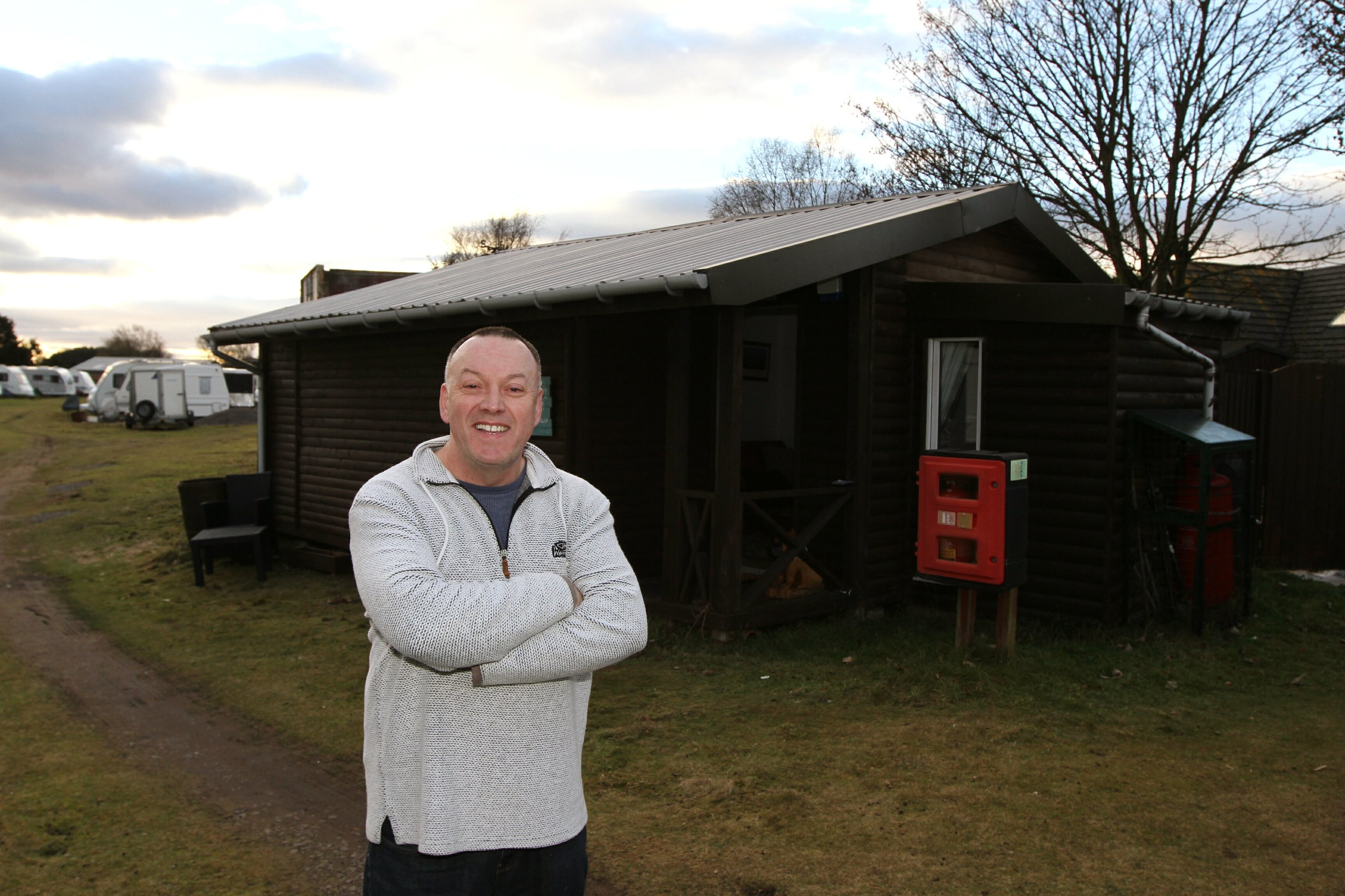 Angus Carnie outside his home, which he has built out of recycled materials costing him £40,000.