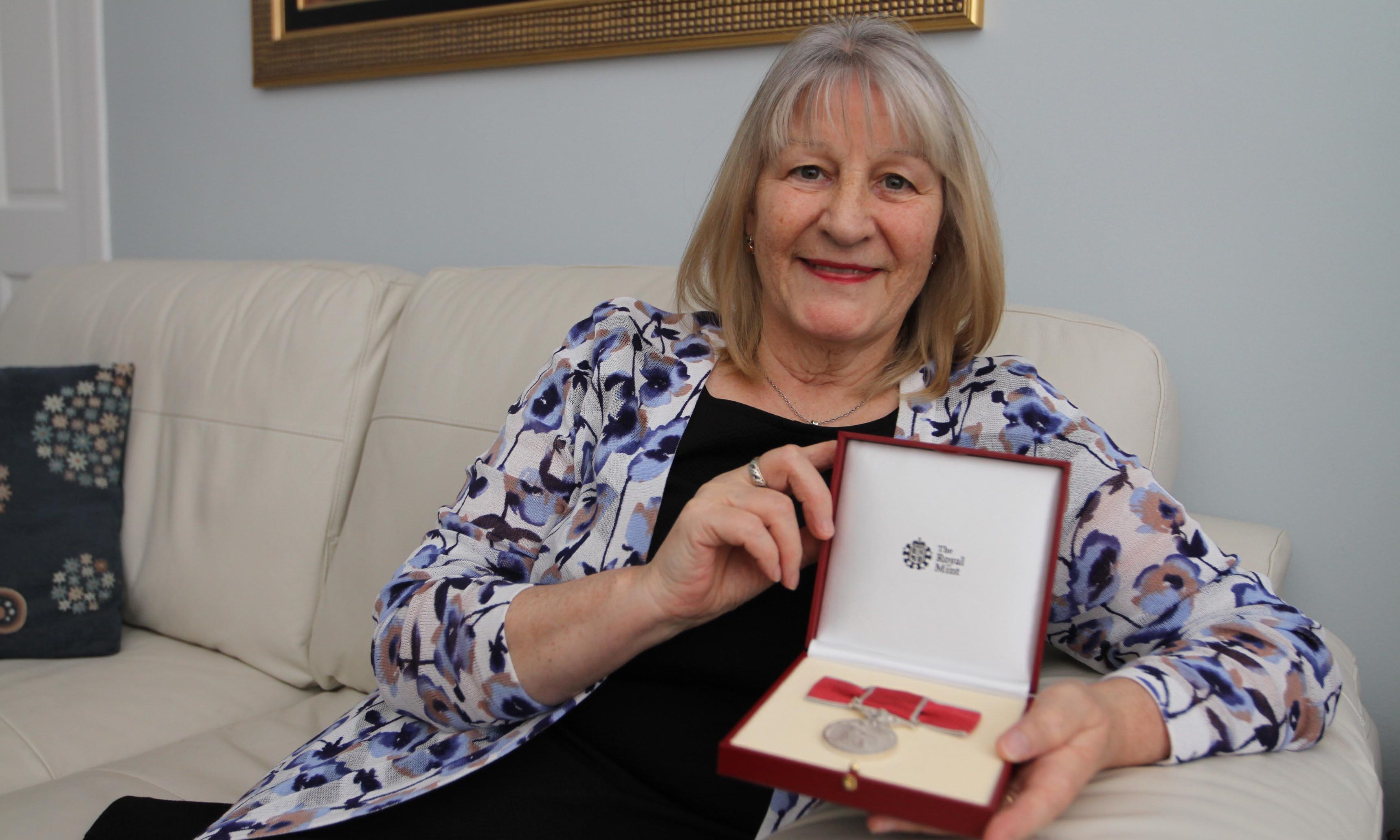 Irene at her Woodside home with her award.