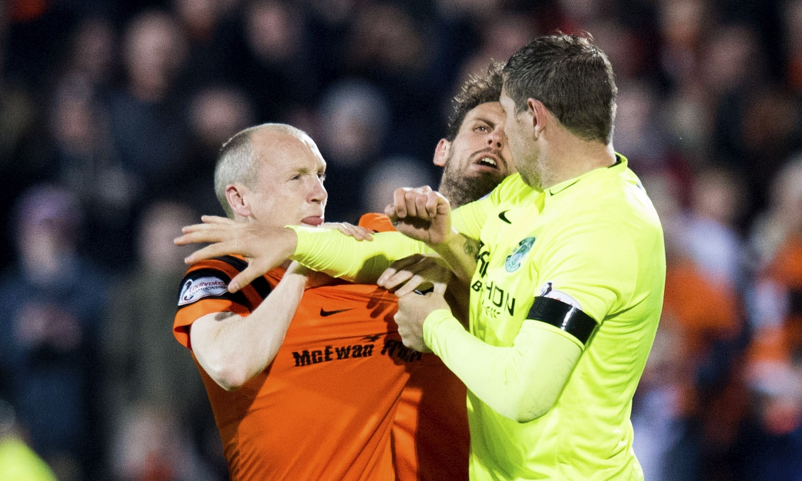 Willo Flood clashes with Hibs Grant Holt the last time the two sides met at the start of December.