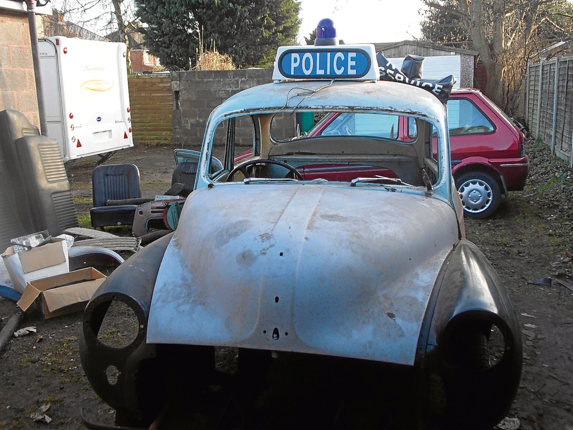 The old Dundee Morris Minor police car, which has been stripped back to its shell.