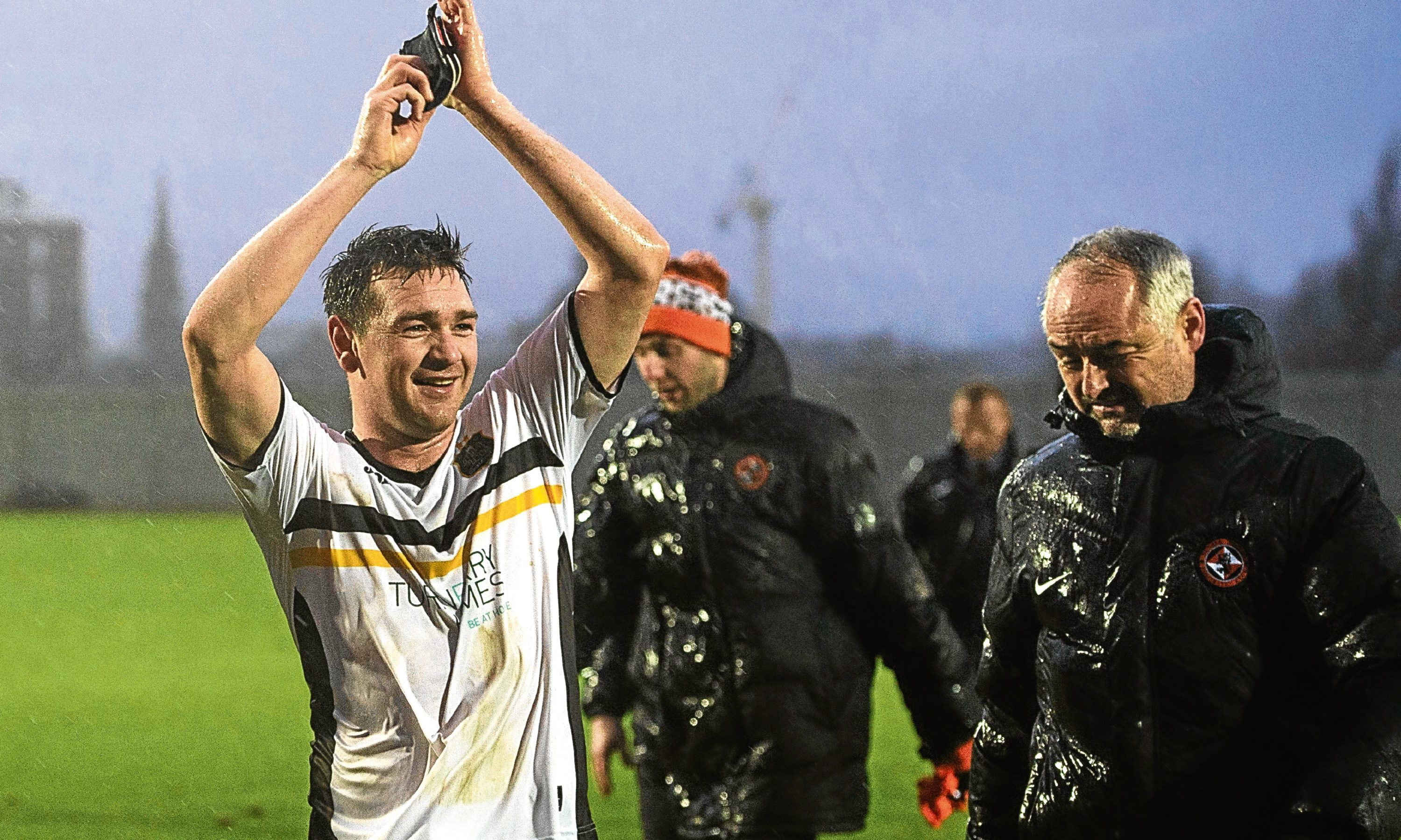 Dundee United boss Ray McKinnon trudges off at Dumbarton as home matchwinner Mark Docherty celebrates.