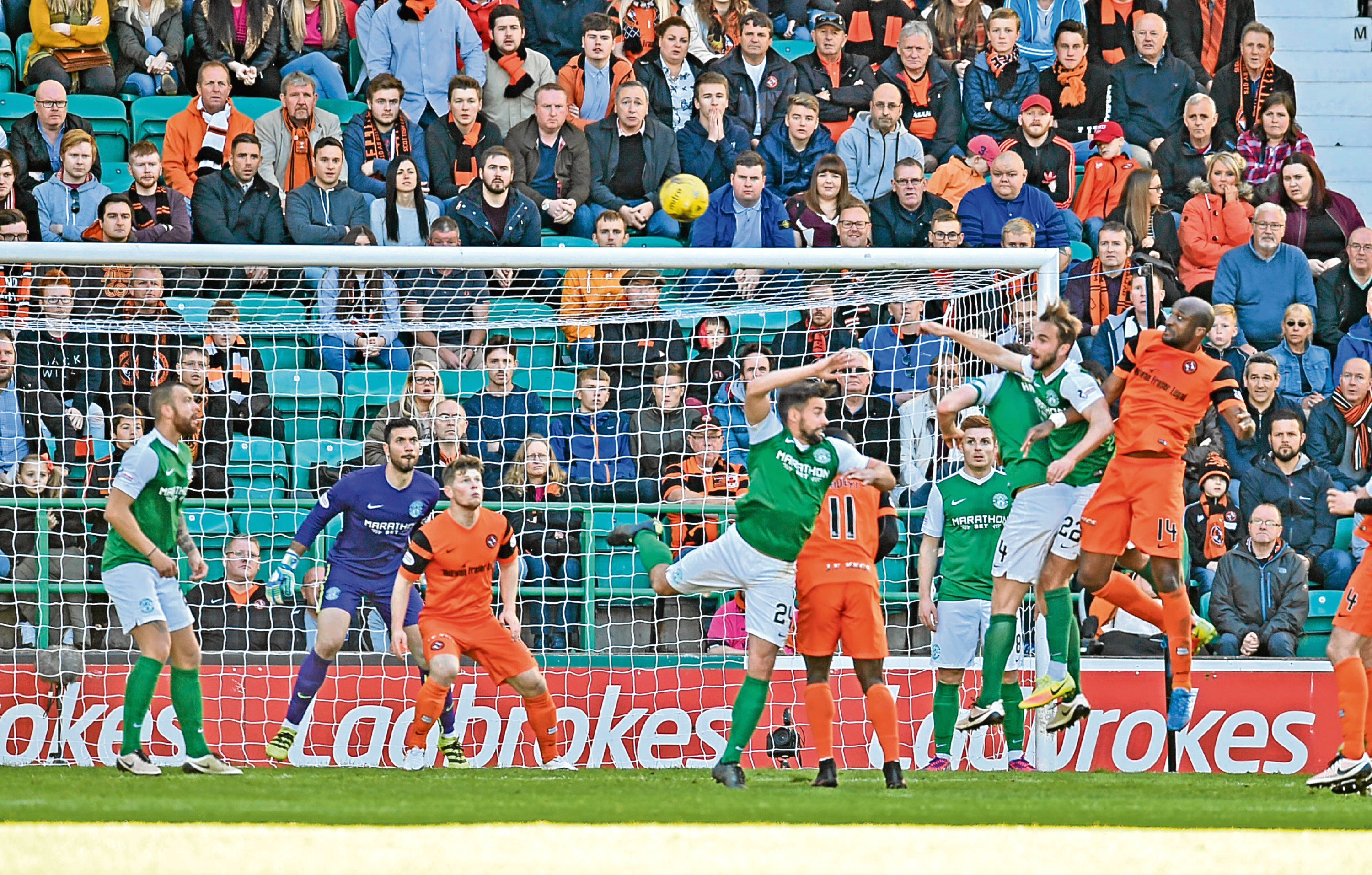 Defender William Edjenguele (right) heads his side level the last time Dundee United travelled to Easter Road to play Hibs.