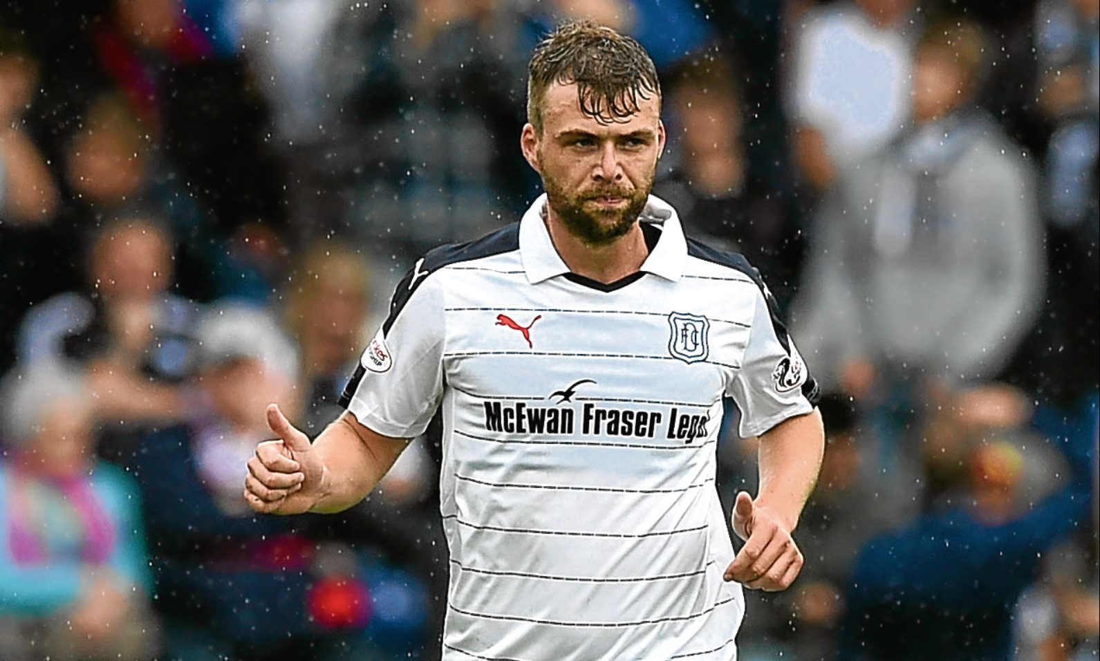 Dundee's Rory Loy in action against Ross County on the first day of the season. The striker has seen little action since then.