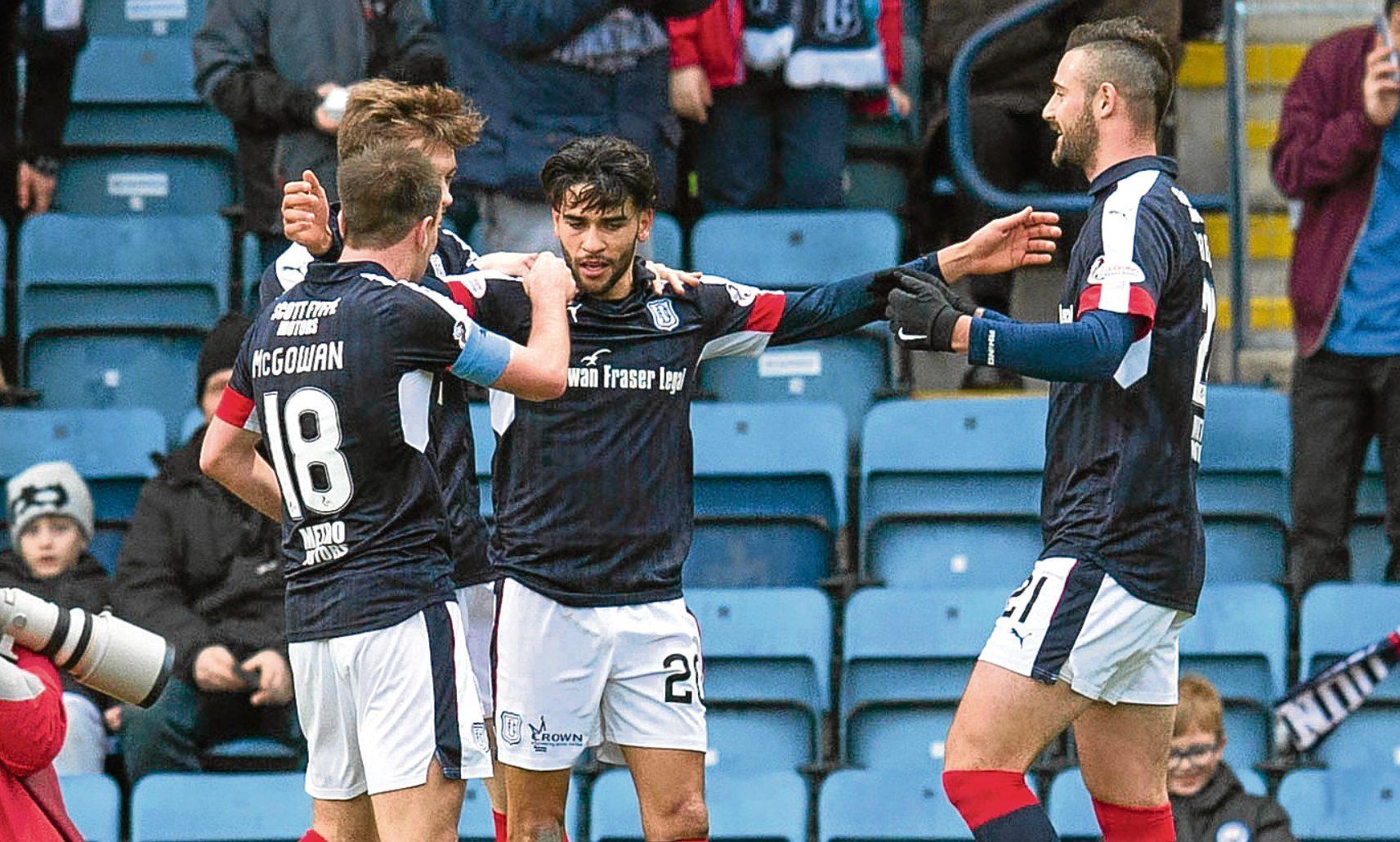 Faissal El Bakhtaoui celebrates opening the scoring against St Johnstone with team-mates Paul McGowan, Craig Wighton and Marcus Haber.