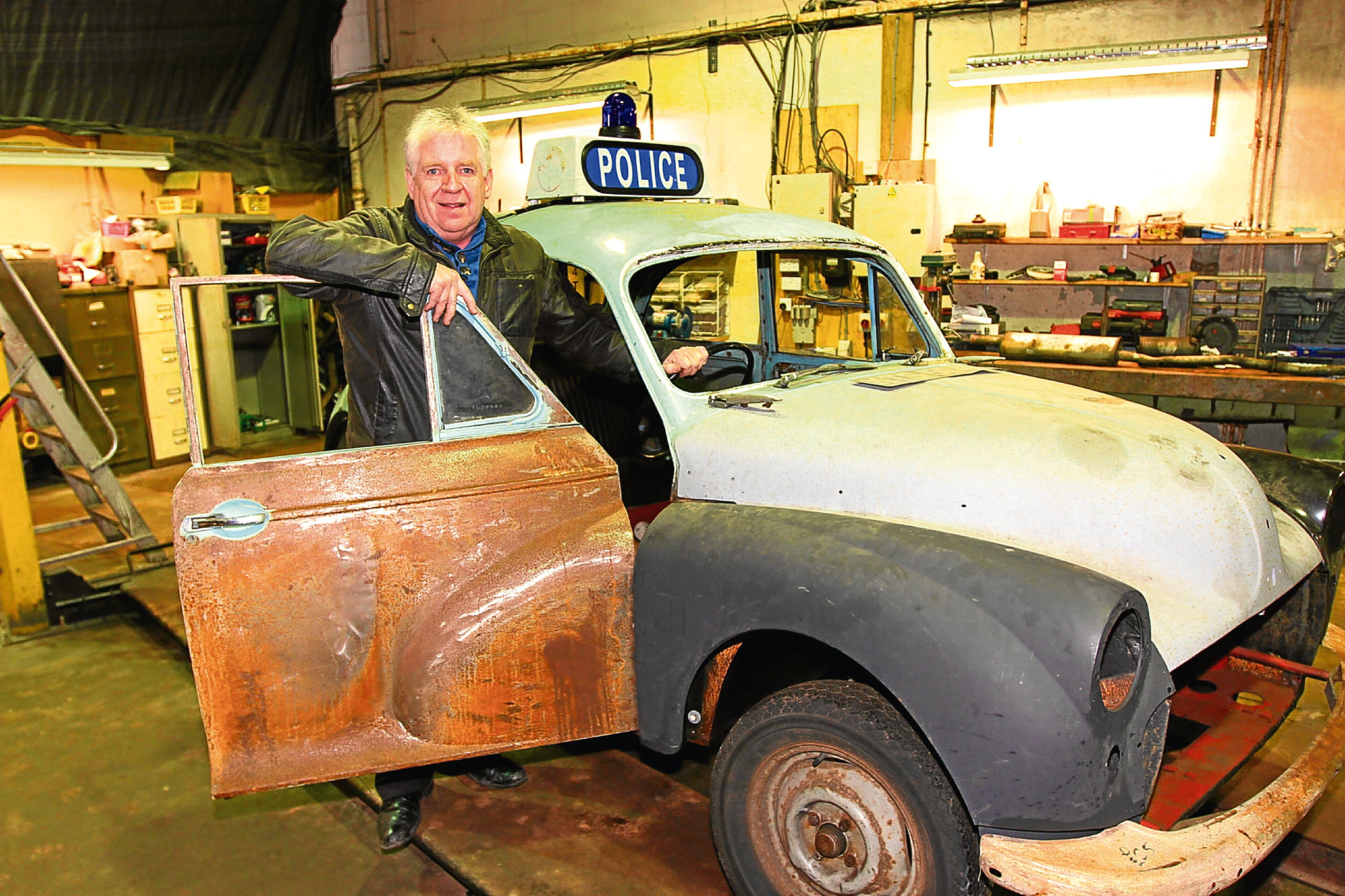 Jim McDonnell at Dundee Museum of Transport where the panda car is being restored.