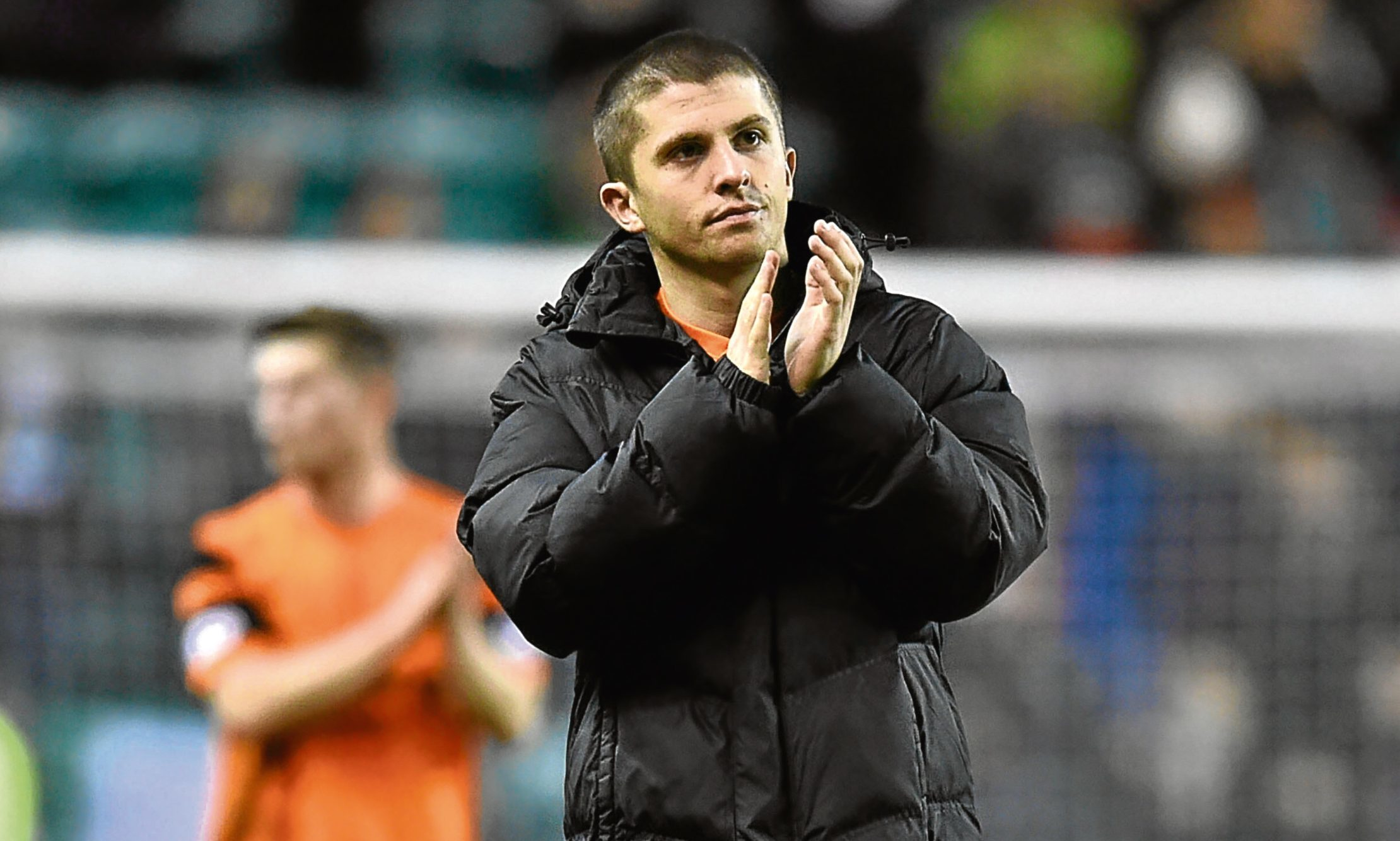 Dundee United midfielder Charlie Telfer applauds the travelling Tangerines fans at Easter Road on Friday night.