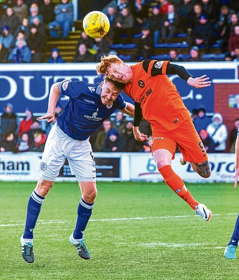 Simon Murray clashes with Chris Higgins at Palmerston in November.