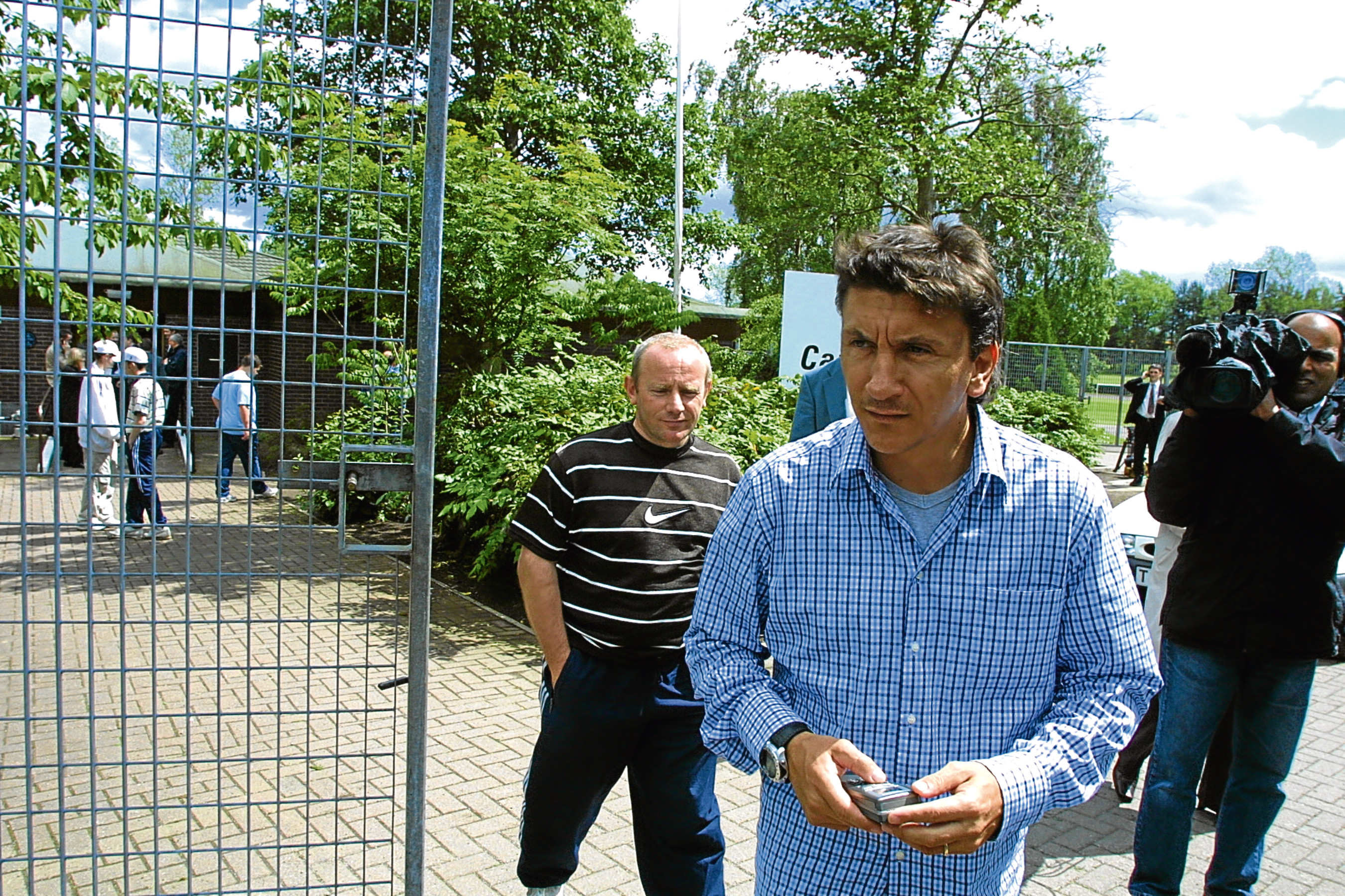 Ivano Bonetti exits the first day back at training after the summer break at Caird Park in 2002.
