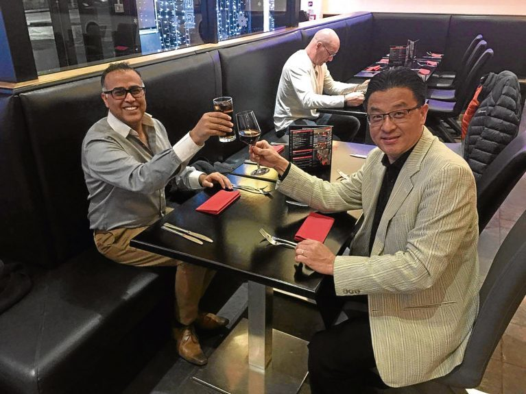 Dundee businessmen Valy Ossman (left) and Steve Chow toasting their new deal to change the Kobee restaurant into a new format,