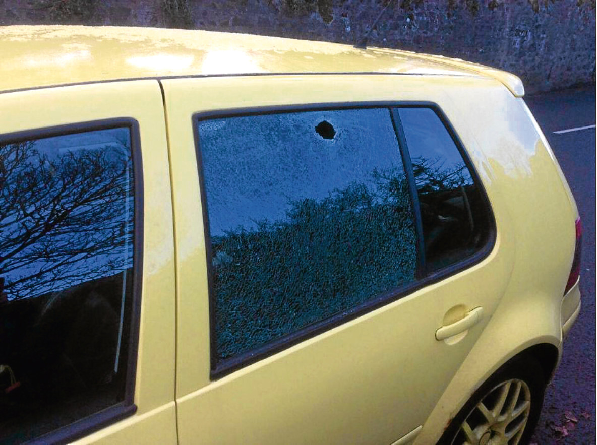 The glass in the rear window of Renee Hepburn's car was shattered.