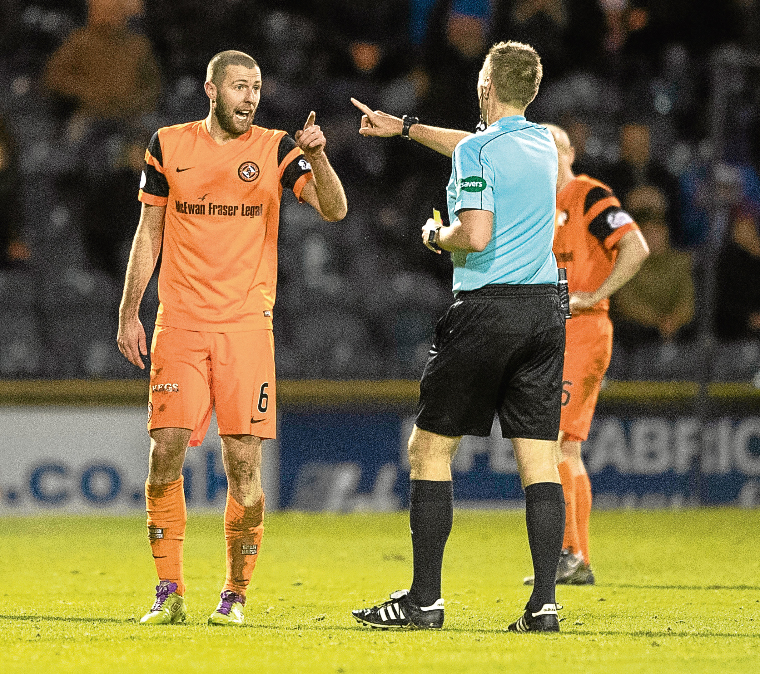 Dundee United's Lewis Toshney talks to referee Steven Kirkland during the goalless draw at Raith.