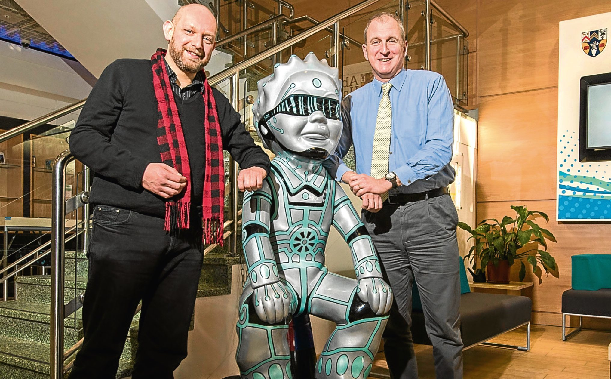 Artist Willie Marr visited his own Oor Wuillie in the reception at Abertay University, with Principal Nigel Seaton