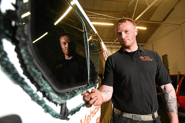 Iain Martin with the damaged van.